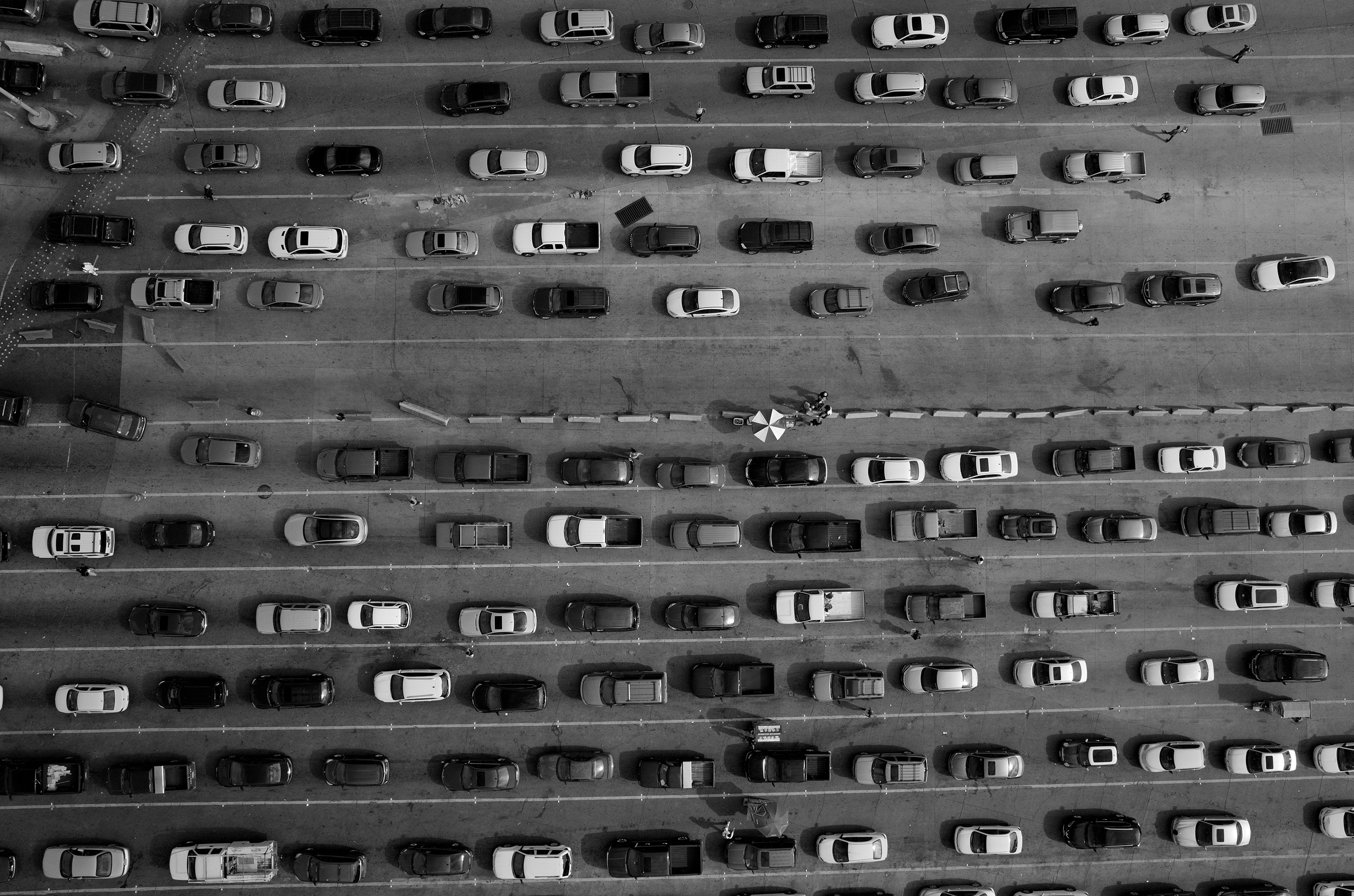 Lanes of cars line up along the U.S.-Mexico border at the port of entry at San Ysidro, California and Tijuana, Baja California. The port is the largest land border crossing point in the world.
