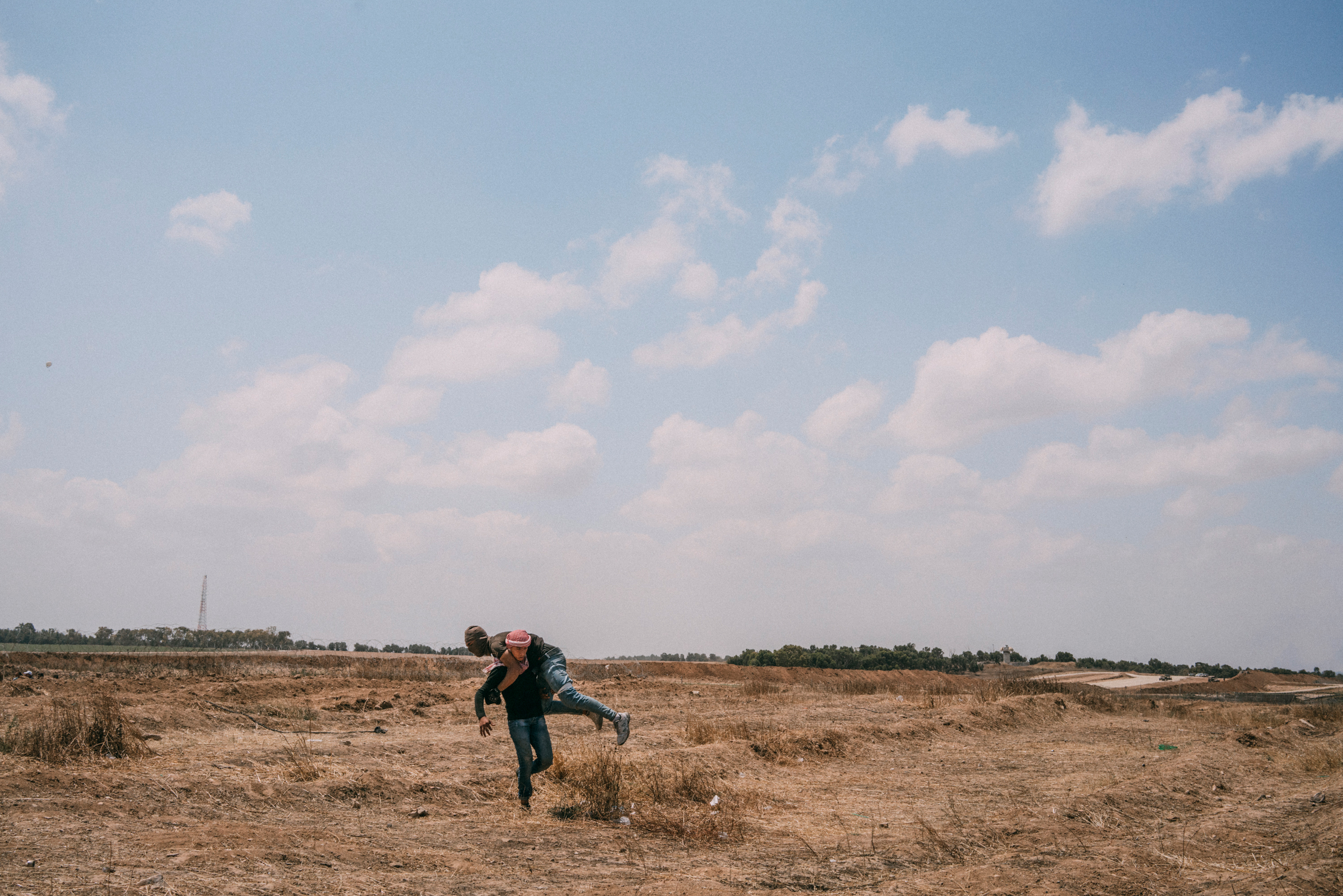 A wounded demonstrator is carried away during the protest along the Gaza-Israel border.