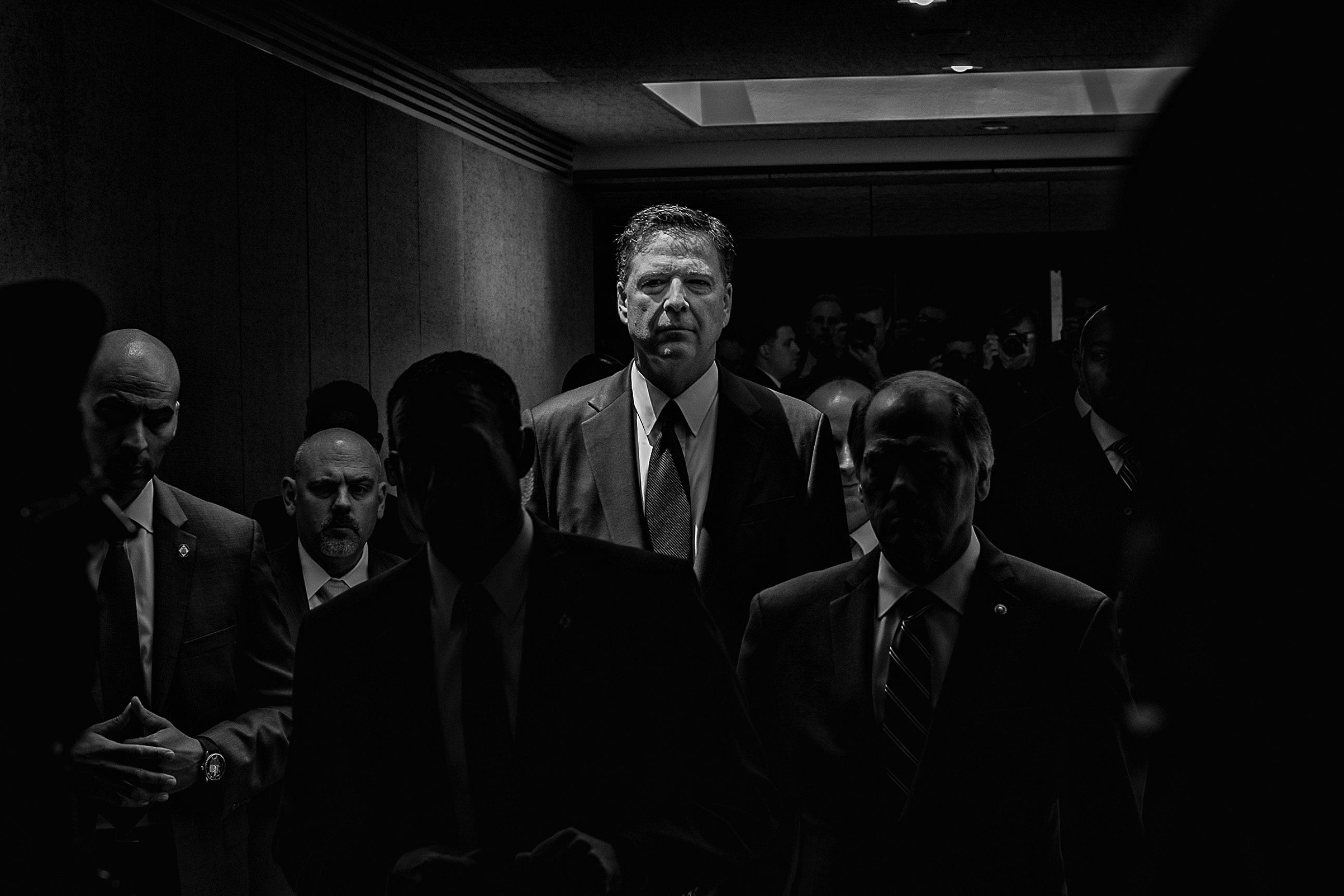 Former FBI Director James Comey leaves a Senate hearing on June 8, 2017, after testifying about Donald Trump