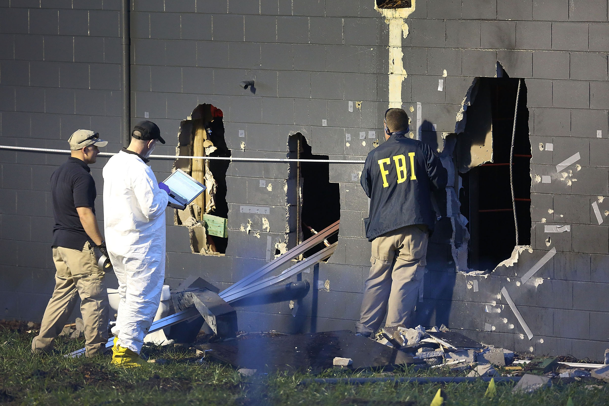 FBI agents at the damaged rear wall of the Pulse nightclub, where Omar Mateen killed 49 people in June 2016