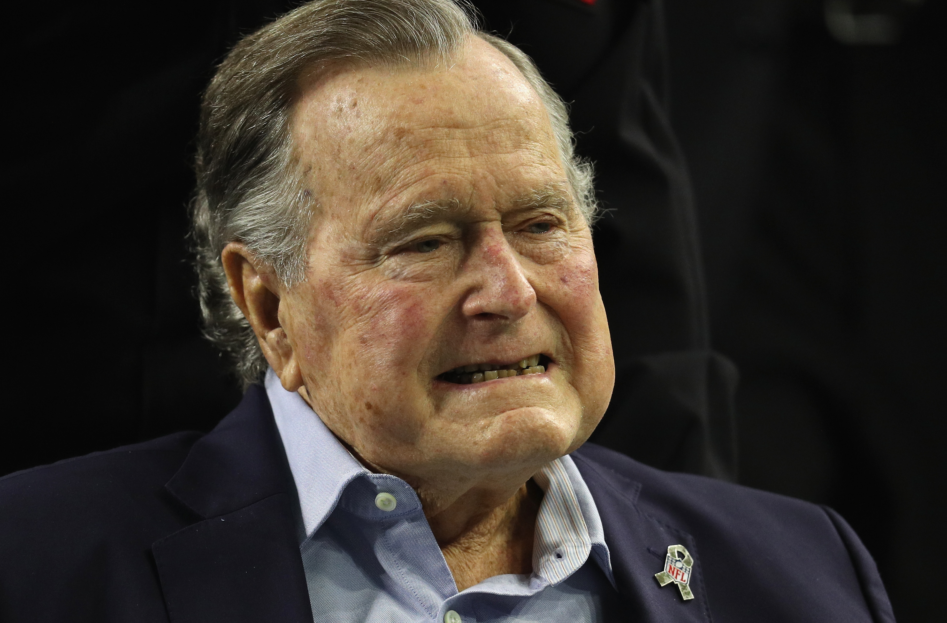 President George H.W. Bush arrives for the coin toss prior to Super Bowl 51.
