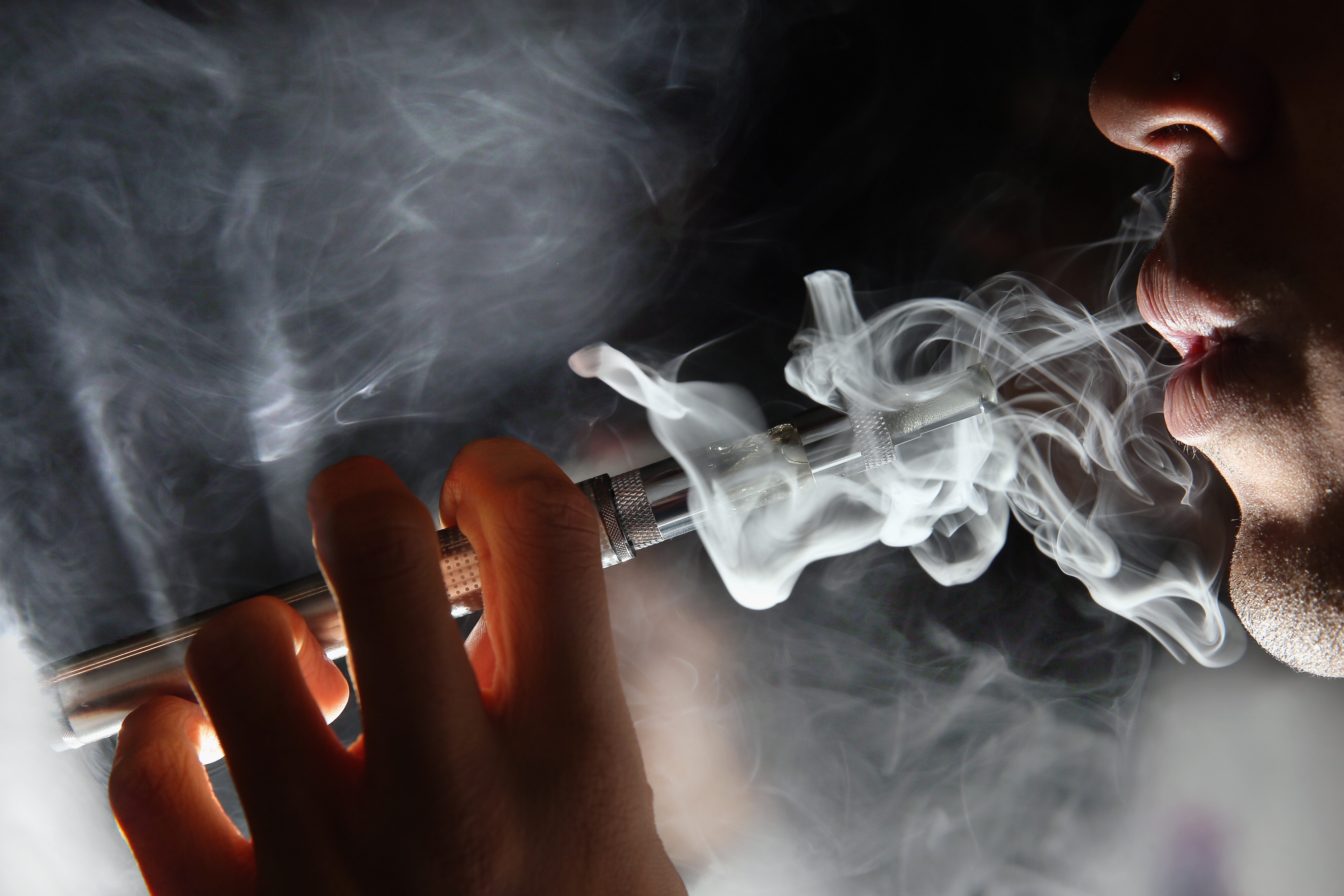 In this photo illustration, a man smokes an E-Cigarette in London on August 27, 2014.