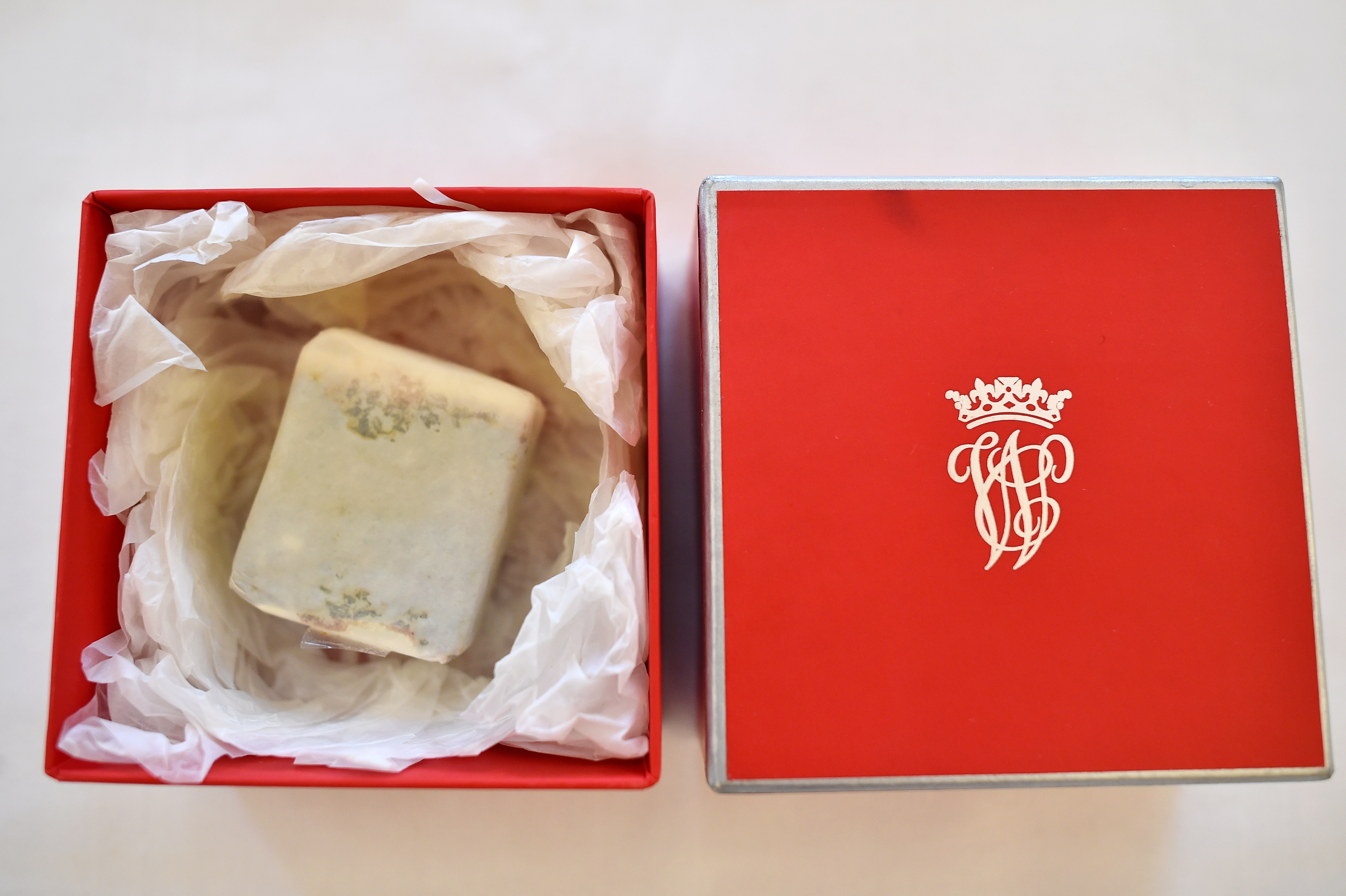 A boxed slice of wedding cake, from the British Royal wedding of Prince William, Duke of Cambridge to Britain's Catherine, Duchess of Cambridge, collected by Leonard Massey, the former first chauffeur to Britain's Queen Elizabeth II, is displayed at the Stafford Hotel in London on June 5, 2015, ahead of its auction in Beverly Hills, US, on June 27.