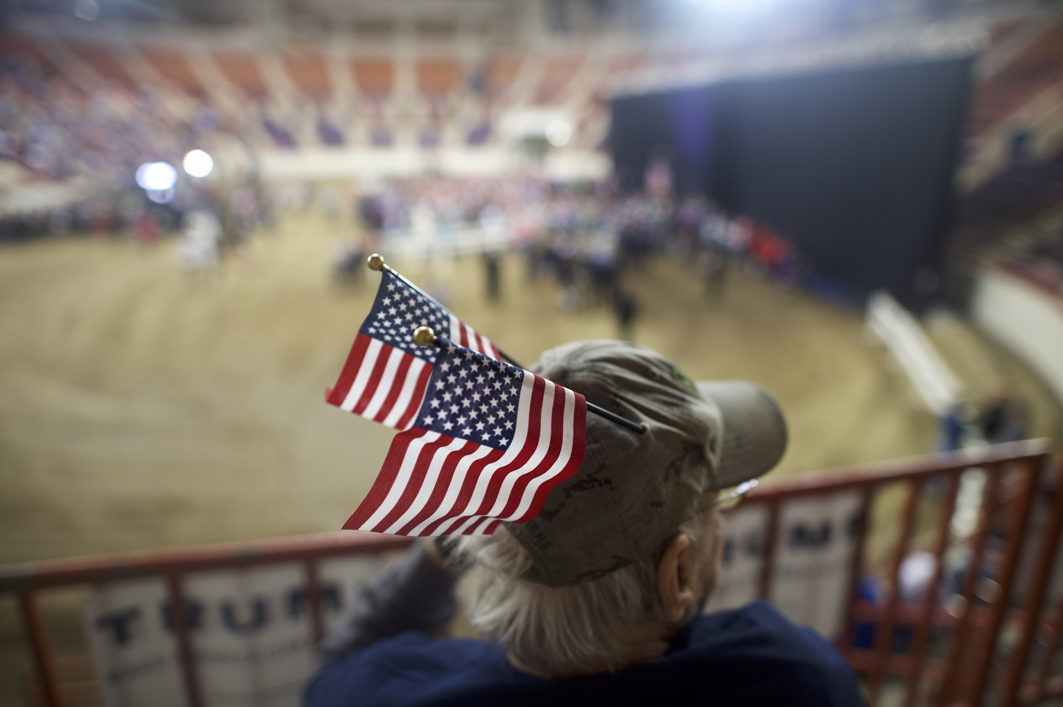 Donald Trump supporters await the start of a rally with the Republican presidential hopeful at the Pennsylvania Farm Show Complex & Expo Center on April 21, 2016 in Harrisburg, Pennsylvania