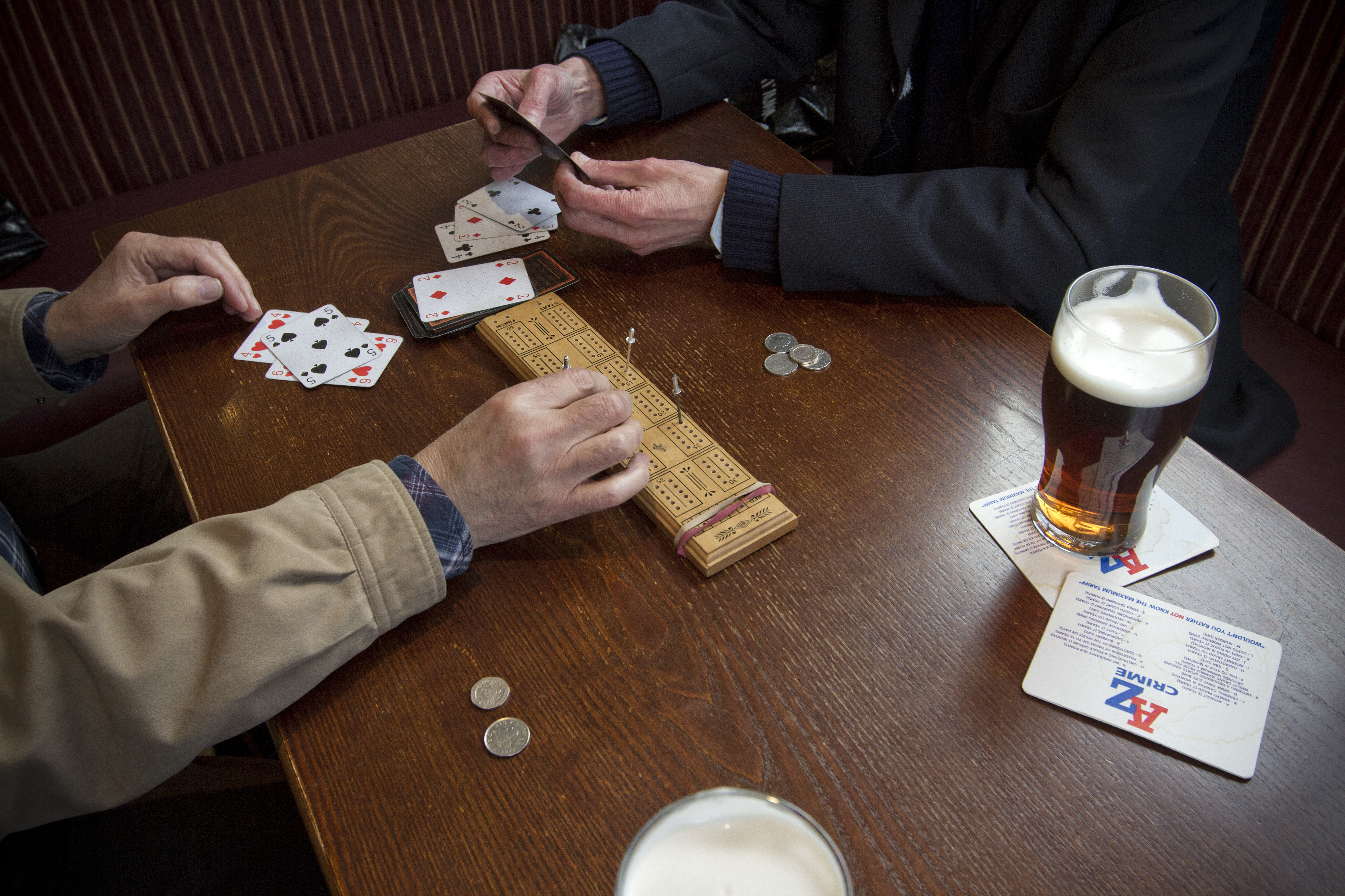 Regulars playing cribbage at the Mowbray in Failsworth, Oldham, Greater Manchester. The pub is owned by Amber Taverns, who reopened in four years ago after the building was previously a public house but had been vacant for a number of years.