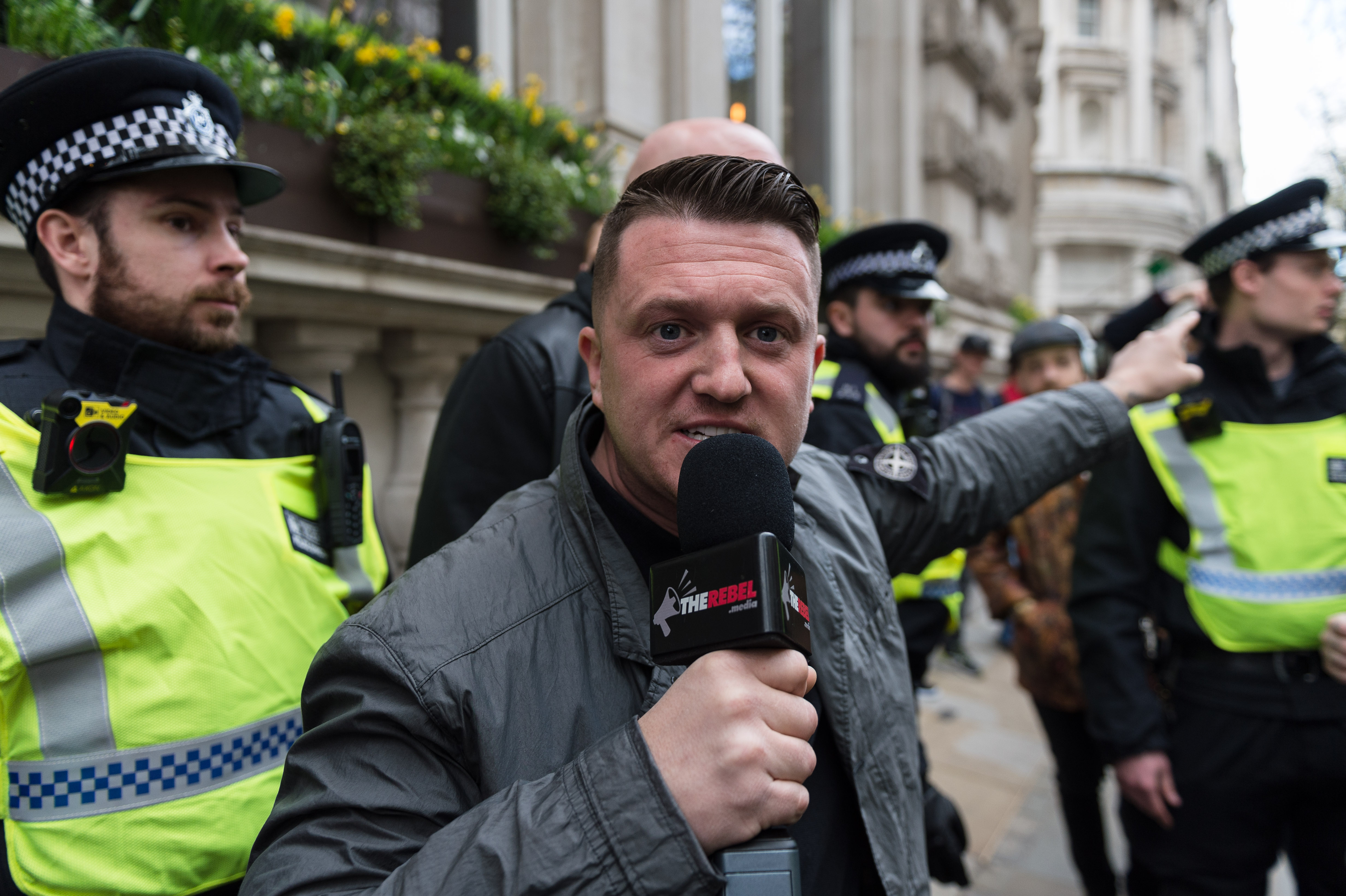 Tommy Robinson, former leader of the English Defence League is escorted by the police as supporters of far-right and anti-Islamic English Defence League (EDL) gather in central London to protest against Islam in the wake of the Westminster terror attack, on April 01, 2017 in London, England.