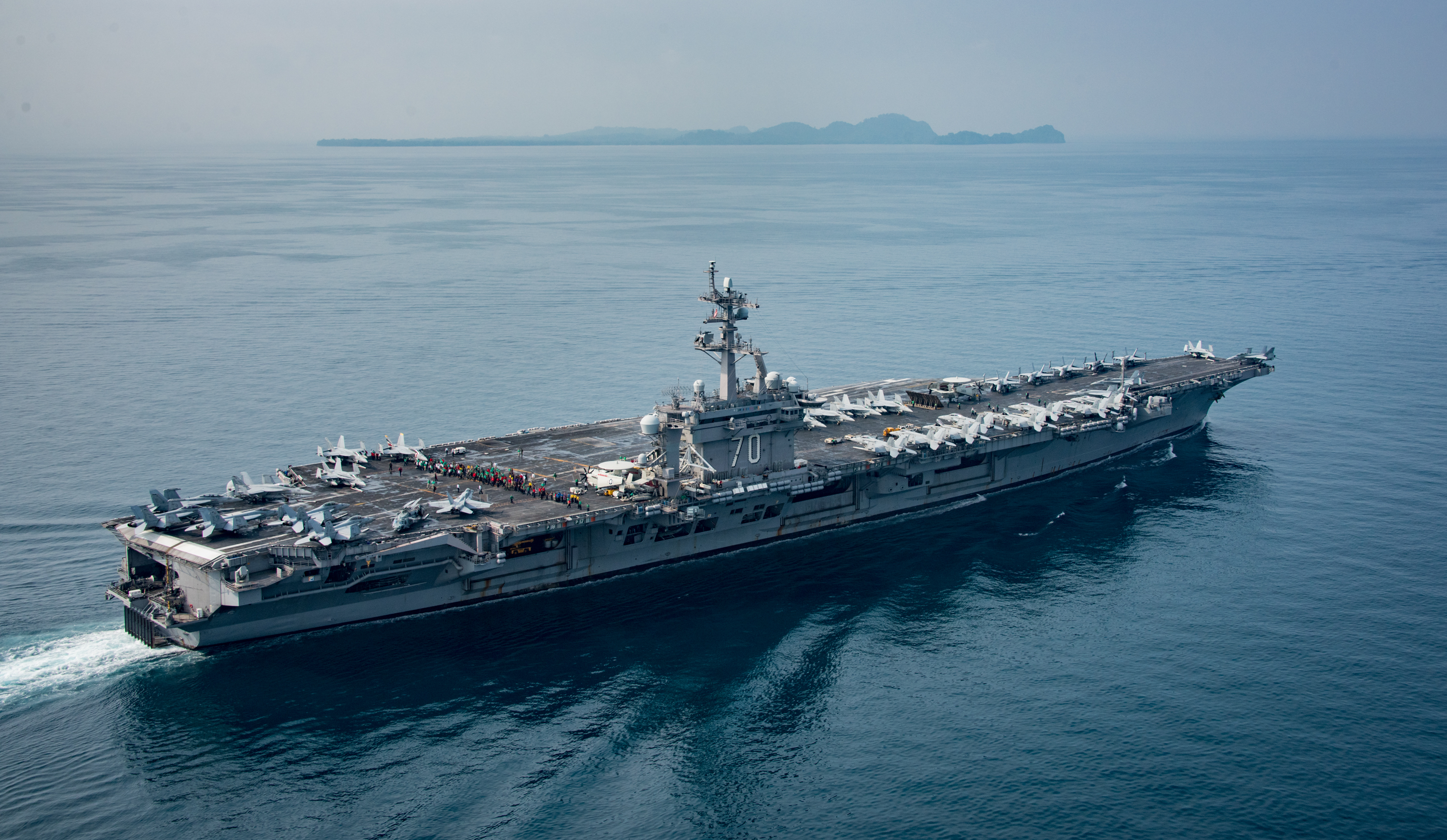 In this handout provided by the U.S. Navy, the aircraft carrier USS Carl Vinson transits the Sunda Strait on April 14, 2017 in Indonesia.