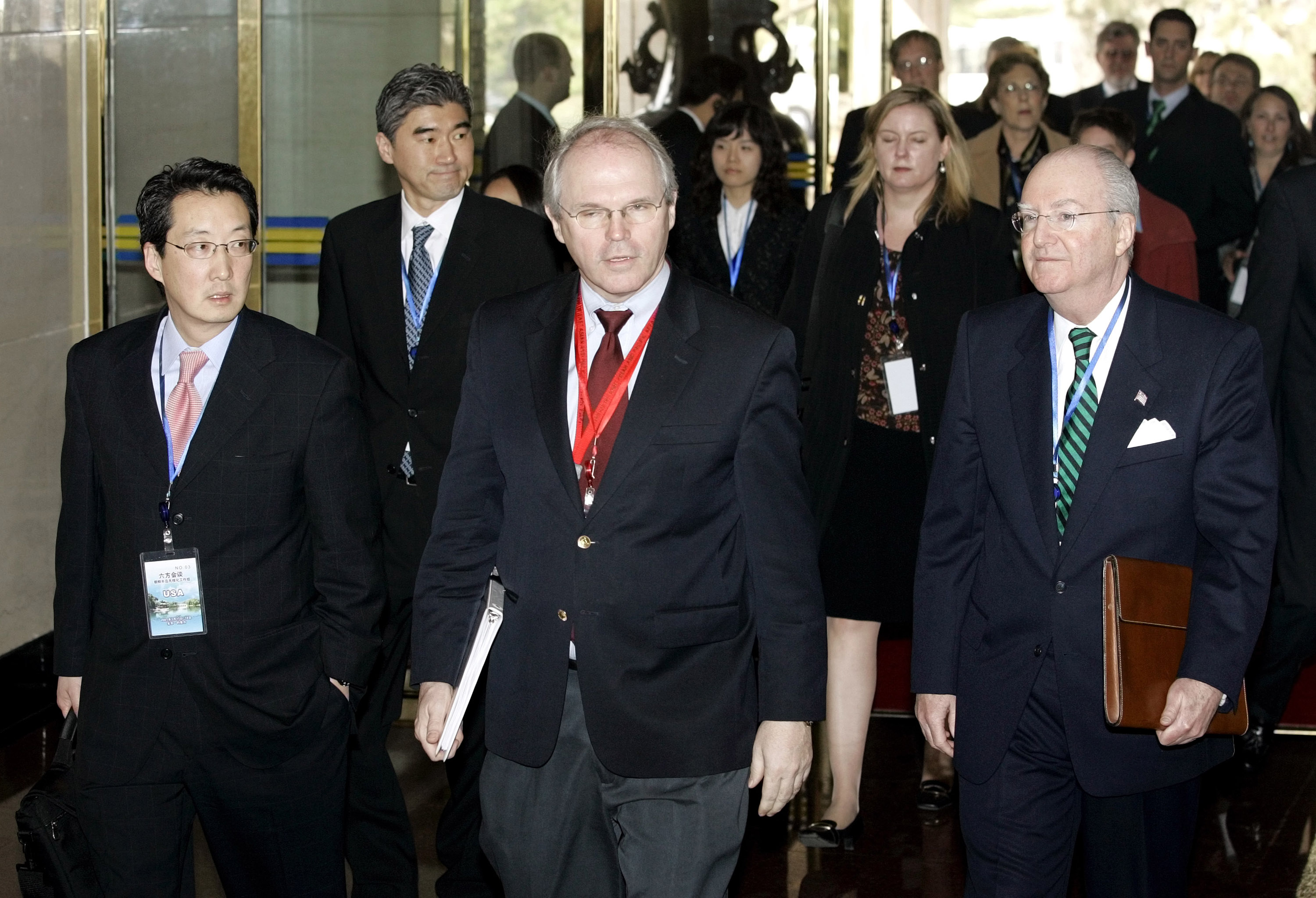I n this March 17 2007 file photo, Victor Cha (L), then the U.S. National Security Council's director for Asian Affairs, arrives with U.S. Assistant Secretary of State Christopher Hill (C), and Ambassador to China Clark Randt (R), at the opening of denuclearization negotiations with North Korea in Beijing