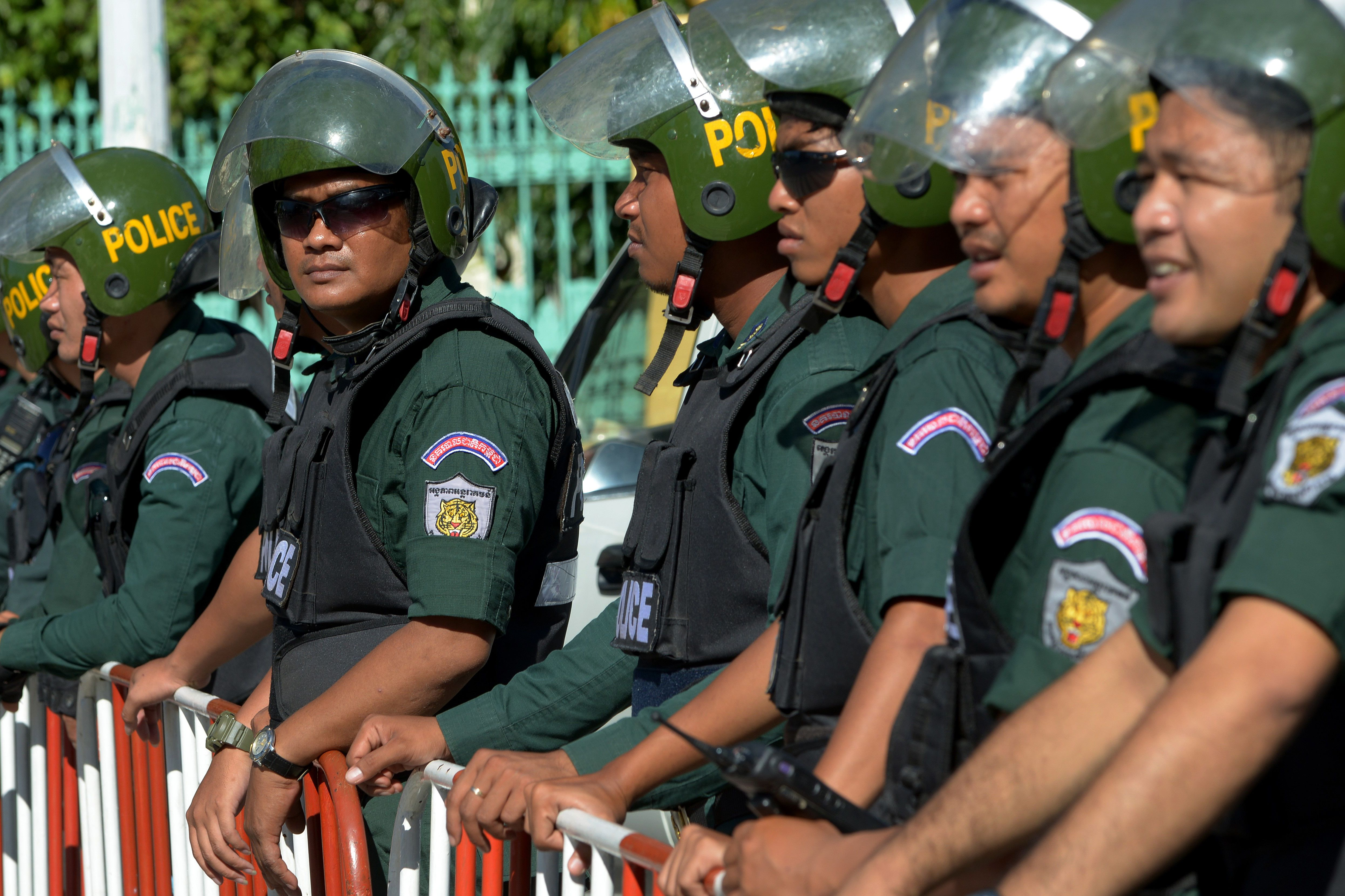 Cambodian police block a street during a rally of lawmakers and supporters of the Cambodia National Rescue Party (CNRP) in Phnom Penh on Sept. 26, 2017.