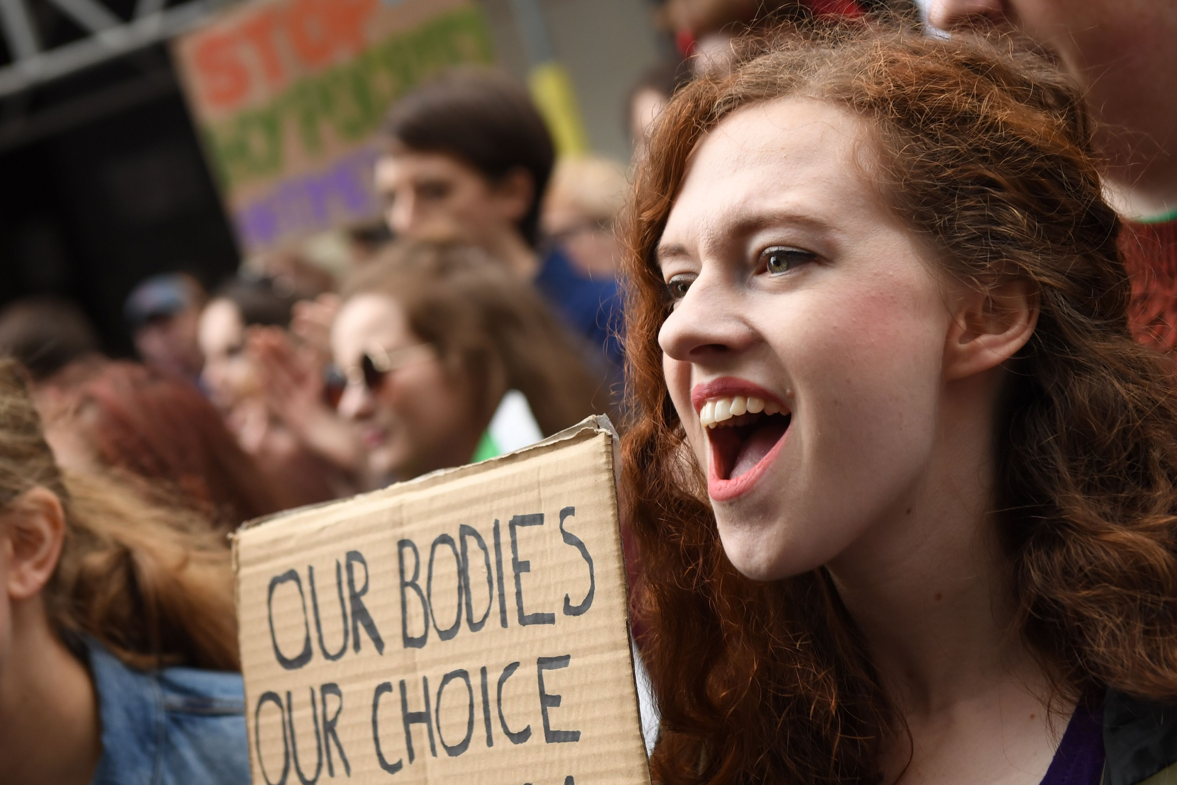 Protesters hold up placards during the London March for Choice, calling for the legalizing of abortion in Ireland after the referendum announcement, outside the Embassy of Ireland in central London on September 30, 2017.