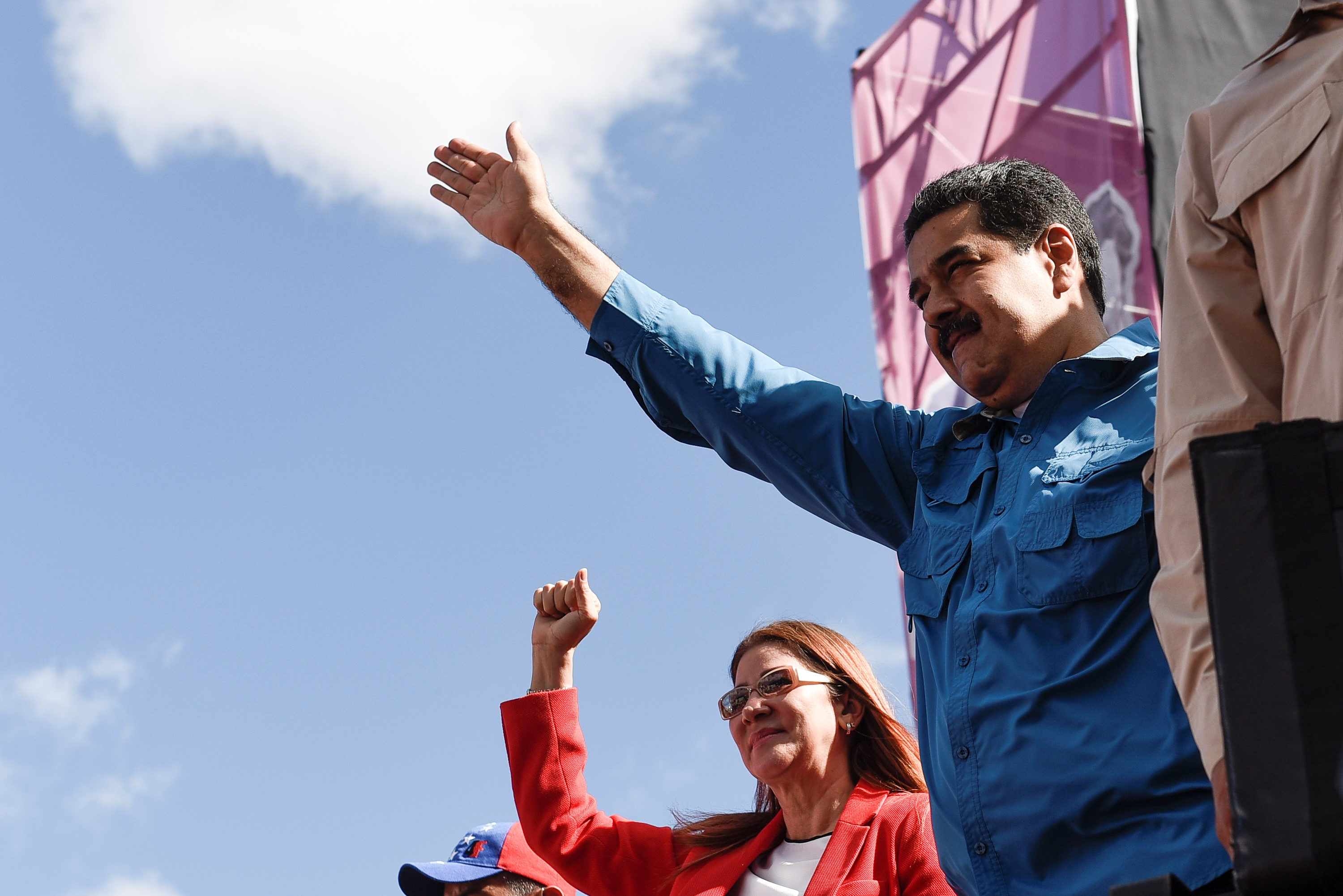 Venezuelan President Nicolas Maduro waves to his supporters during a rally in Caracas, Venezuela on Jan. 23, 2018.
