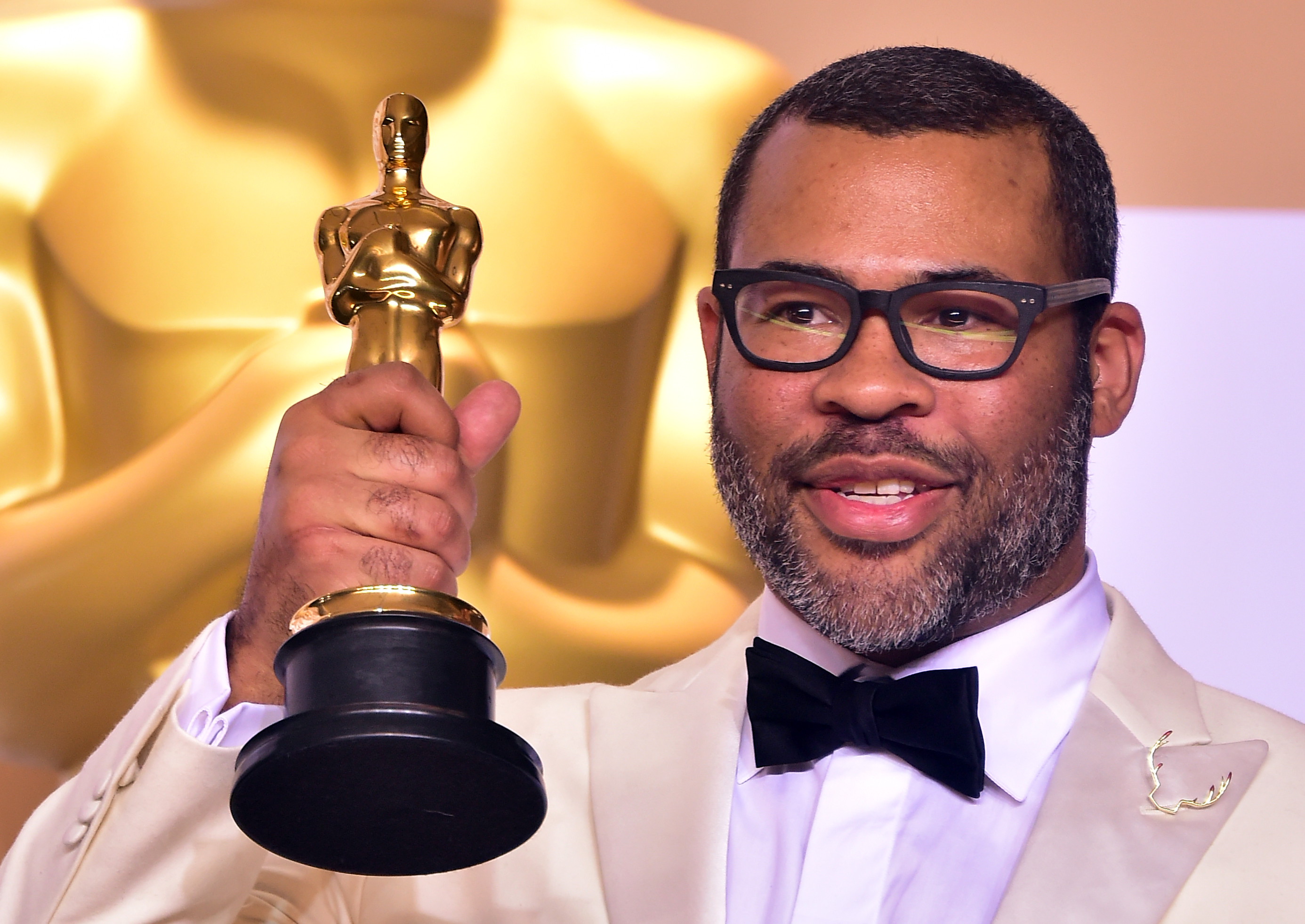 Director Jordan Peele in with the Oscar for best original screenplay during the 90th Annual Academy Awards on March 4, 2018, in Hollywood, California.