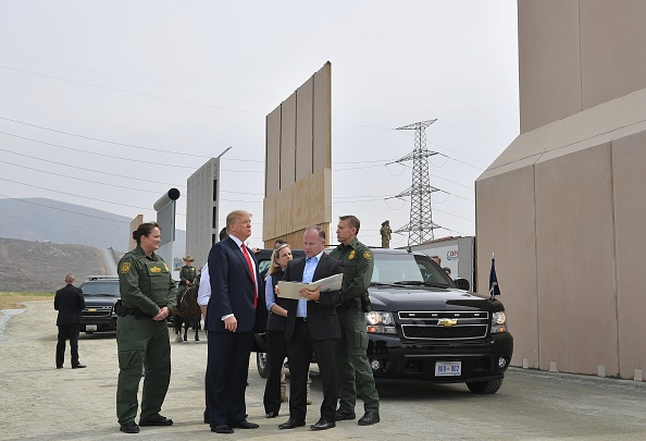 President Donald Trump inspects border wall prototypes in California in 2018. (Getty)