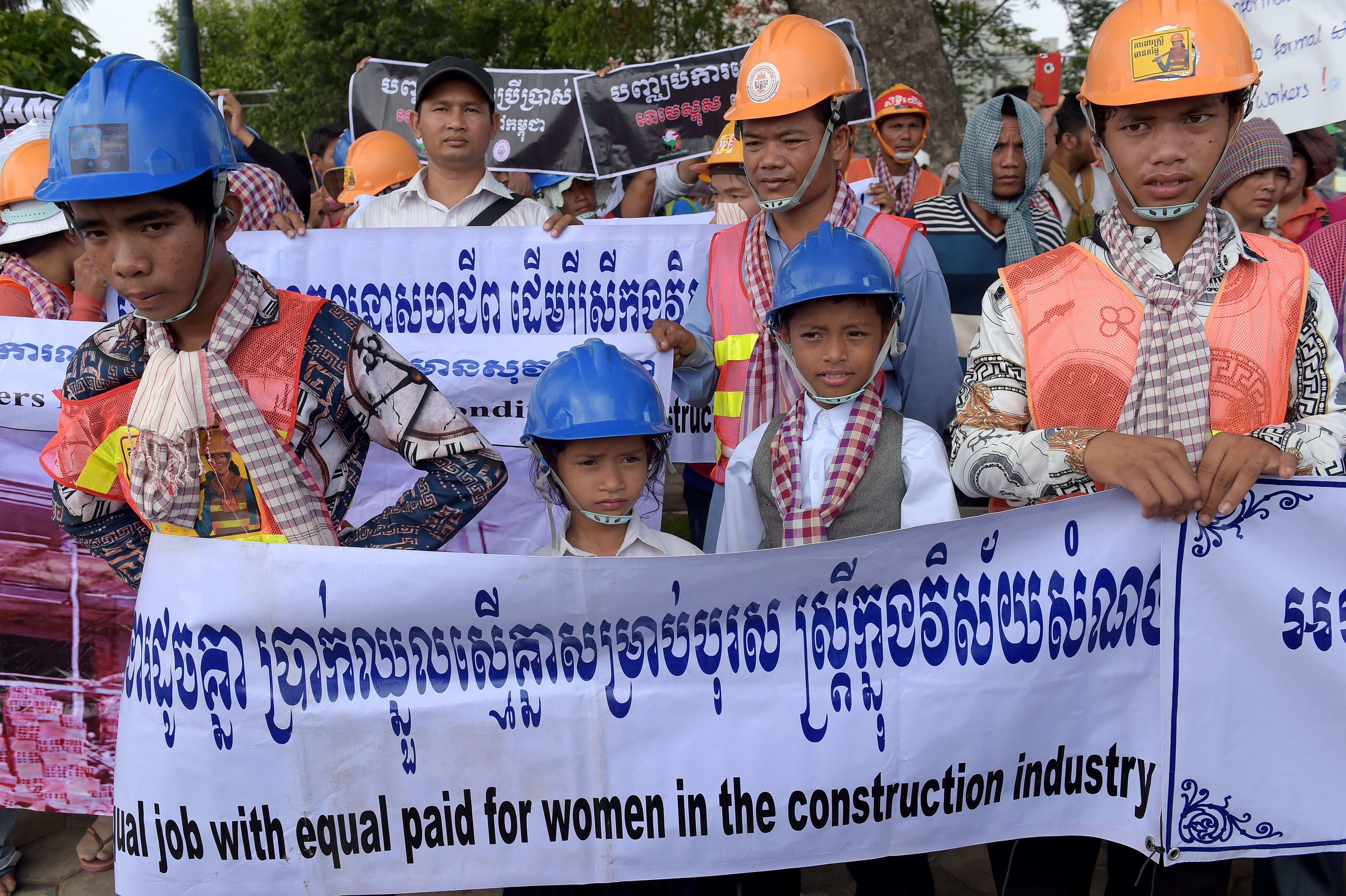 Workers hold placards and banners during a gathering to mark International Labour Day, or May Day, in Phnom Penh, Cambodia on May 1, 2018.