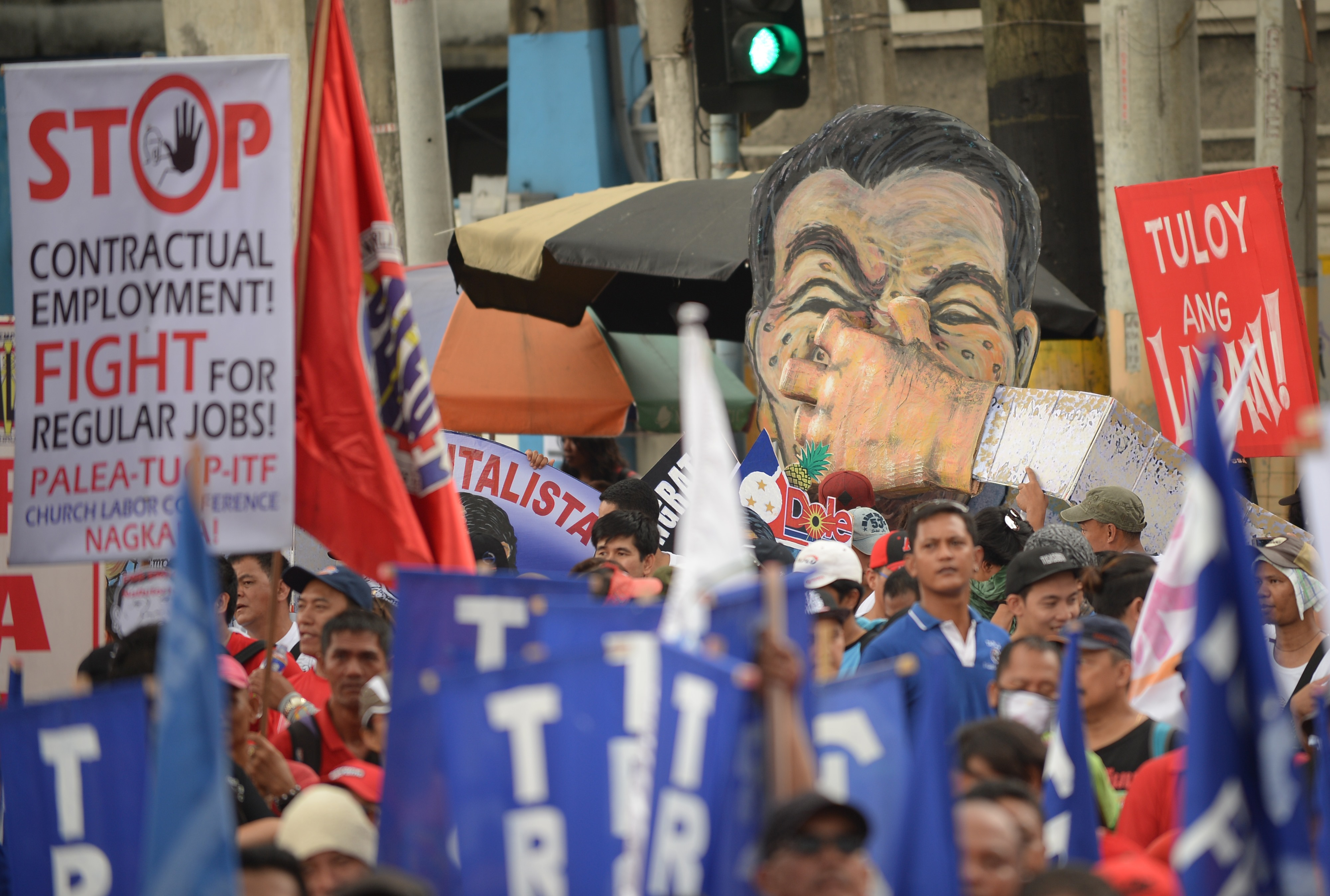 Laborers and activists carry an effigy of President Rodrigo Duterte as they march towards Malacanang presidential palace during the May Day rally in Manila, Philippines on May 1, 2018.