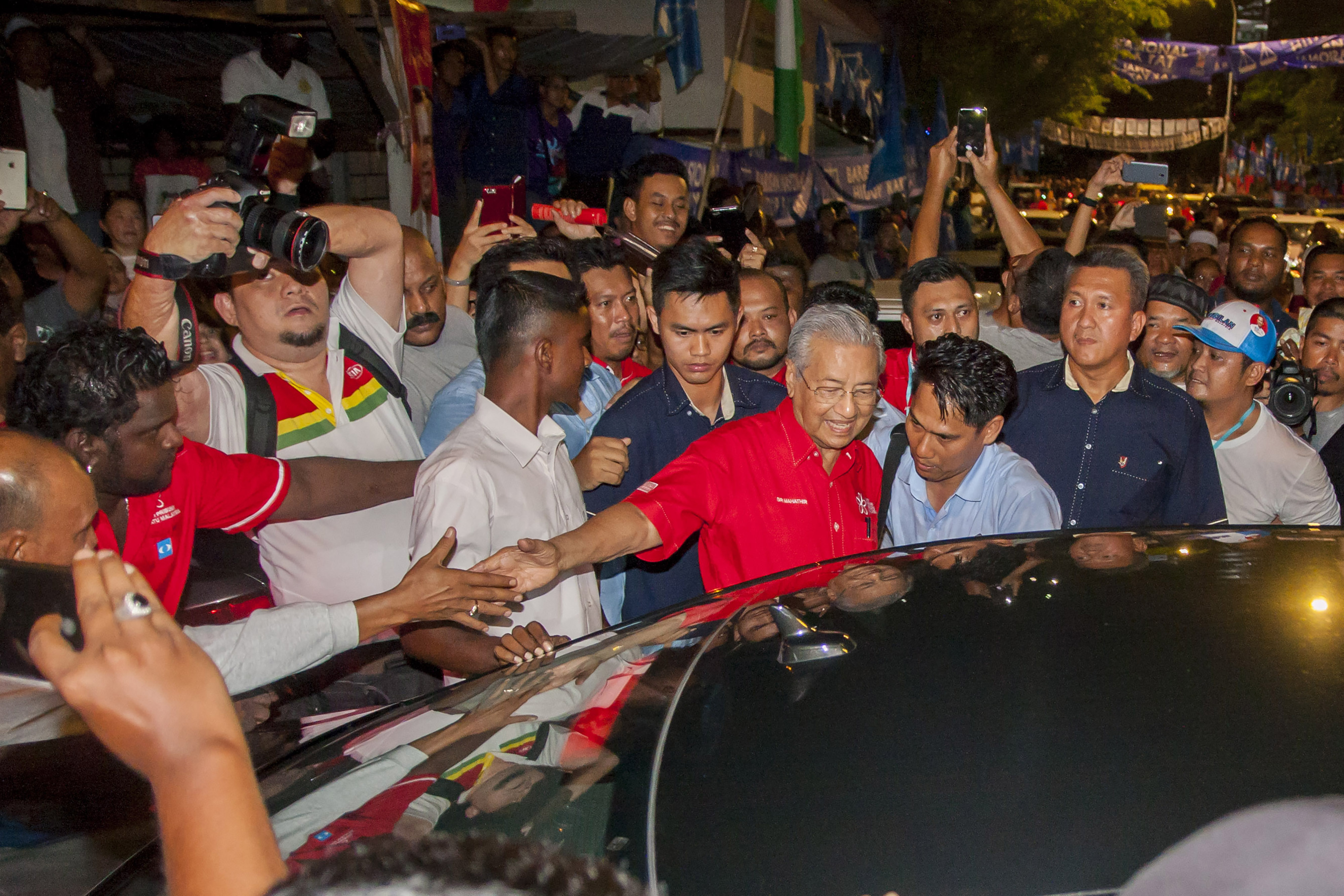 Dr Mahathir Mohamad the former Malaysian prime minister seen shaking hands with one supporter while leaving the Pakatan Harapan campaign rally at PPR Kerinchi, Kuala Lumpur.