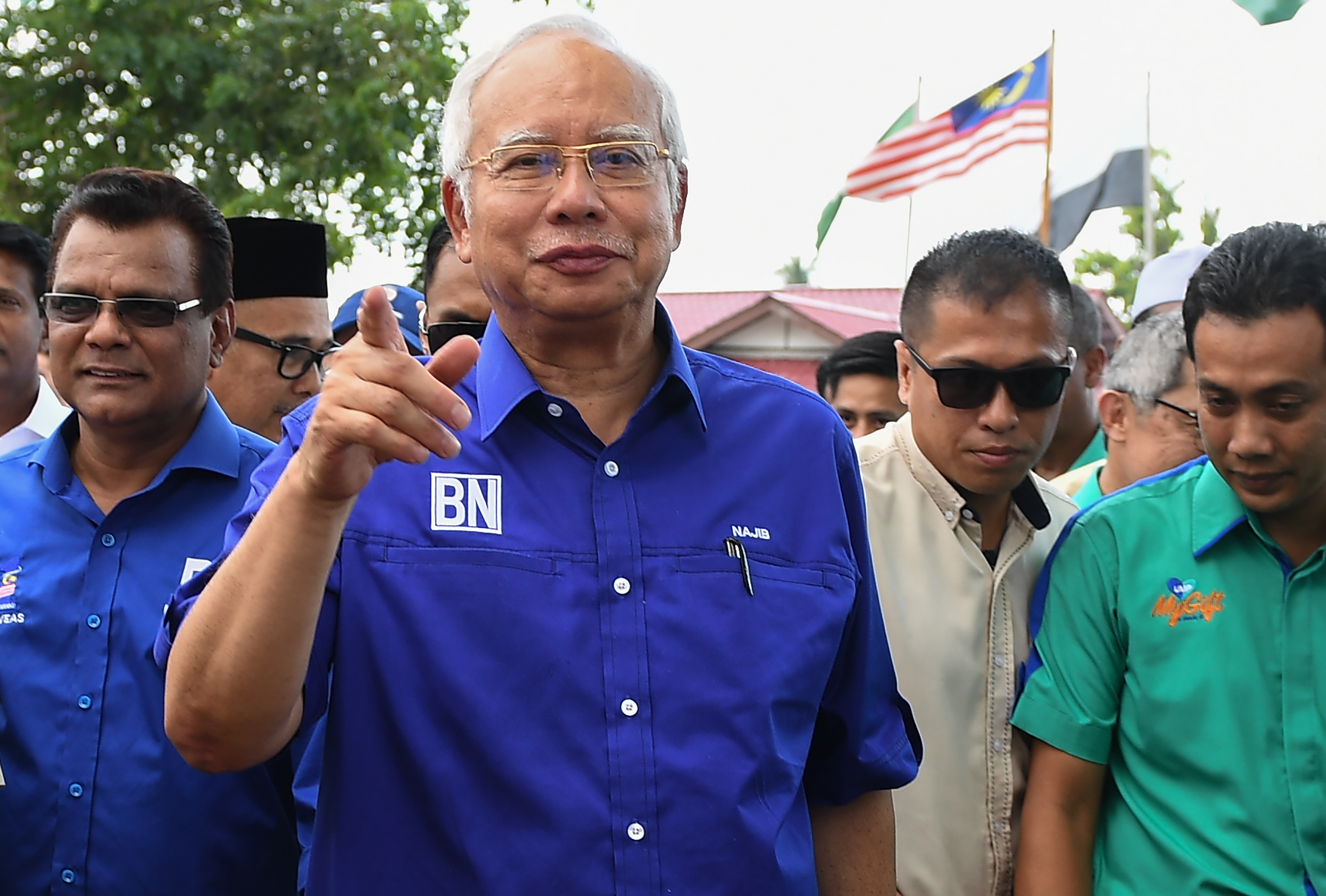 Malaysia's Prime Minister Najib Razak of the ruling coalition party Barisan Nasional arrives during a campaign event ahead of the upcoming 14th general election in Pekan, Pahang on May 8, 2018.