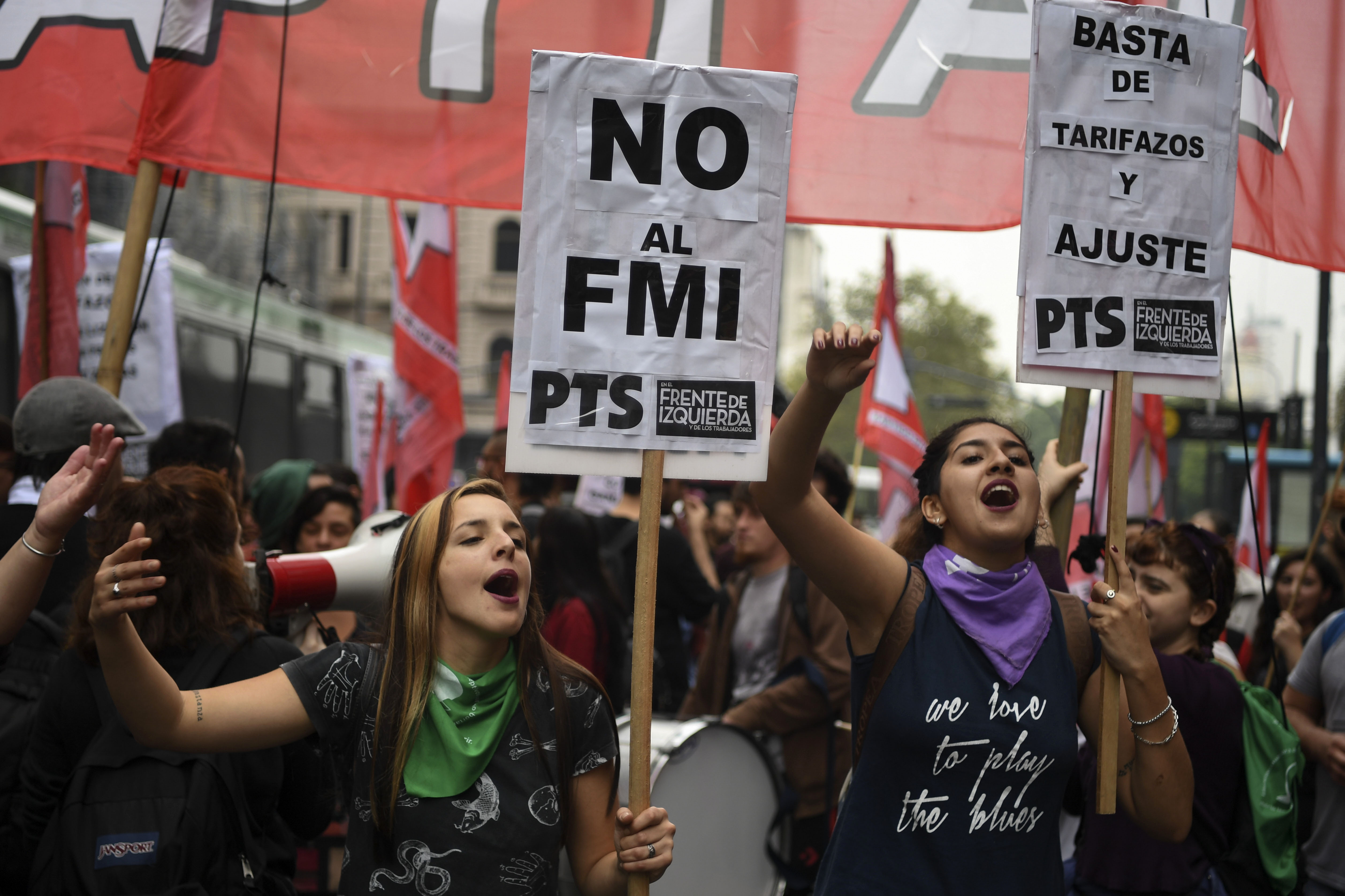 Members of leftist organizations demonstrate outside the National Congress against the government's negotiations with the IMF while legislators debate a bill to put a stop on public services taxes raising in Buenos Aires, on May 09, 2018. - Argentina opened talks with the International Monetary Fund on Tuesday to seek a financial aid package, 17 years after the country defaulted on its debt and 12 years after cutting ties with the fund. (Photo by EITAN ABRAMOVICH / AFP)        (Photo credit should read EITAN ABRAMOVICH/AFP/Getty Images)
