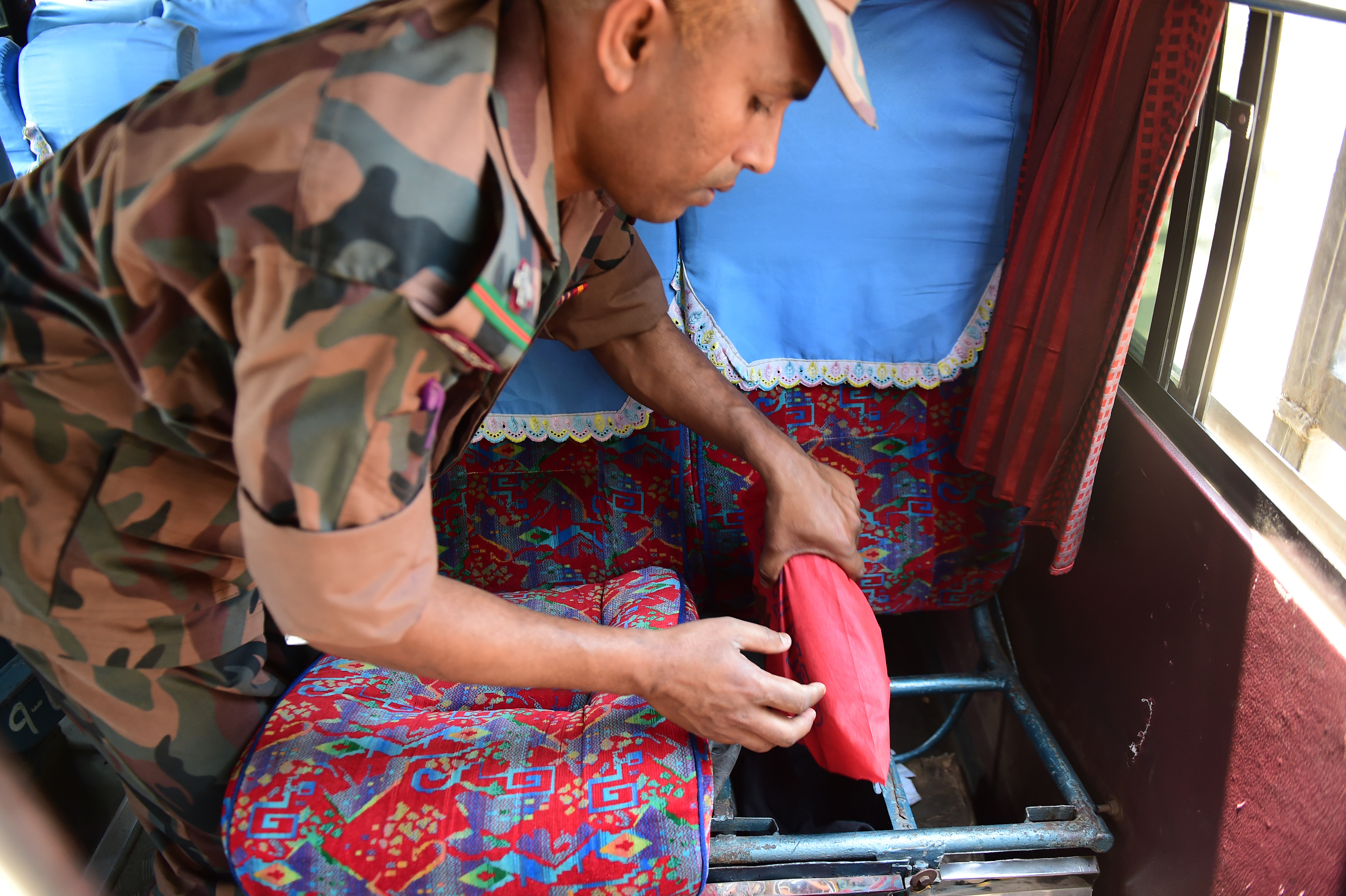 A Bangladesh Border Guard (BGB) discovers  yaba  on a passenger bus on April 6, 2018.