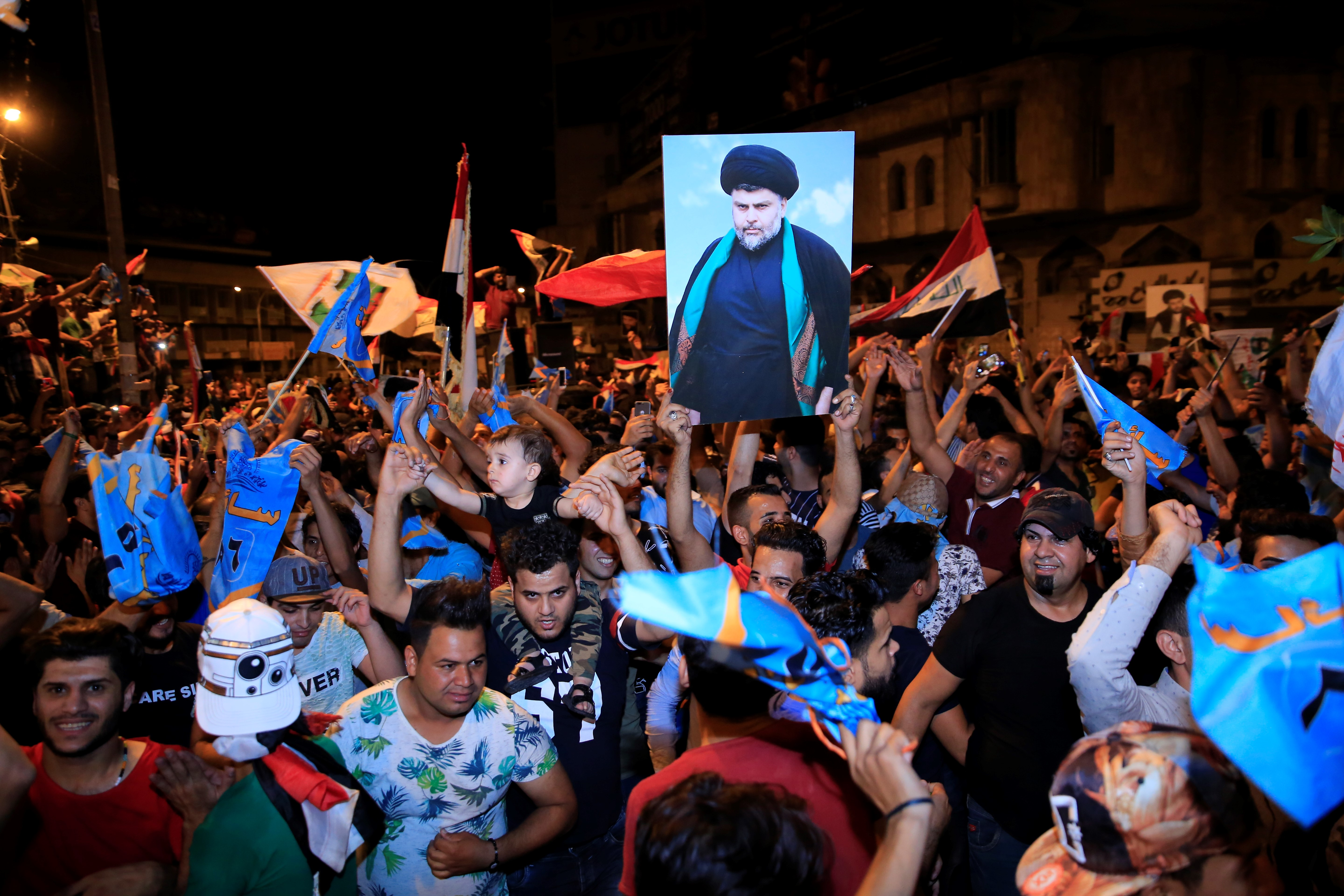 Supporters of Iraqi Shiite cleric Muqtada al-Sadr celebrate the results of the parliamentary election at the Tahrir Square, Baghdad, Iraq, on May 13, 2018.