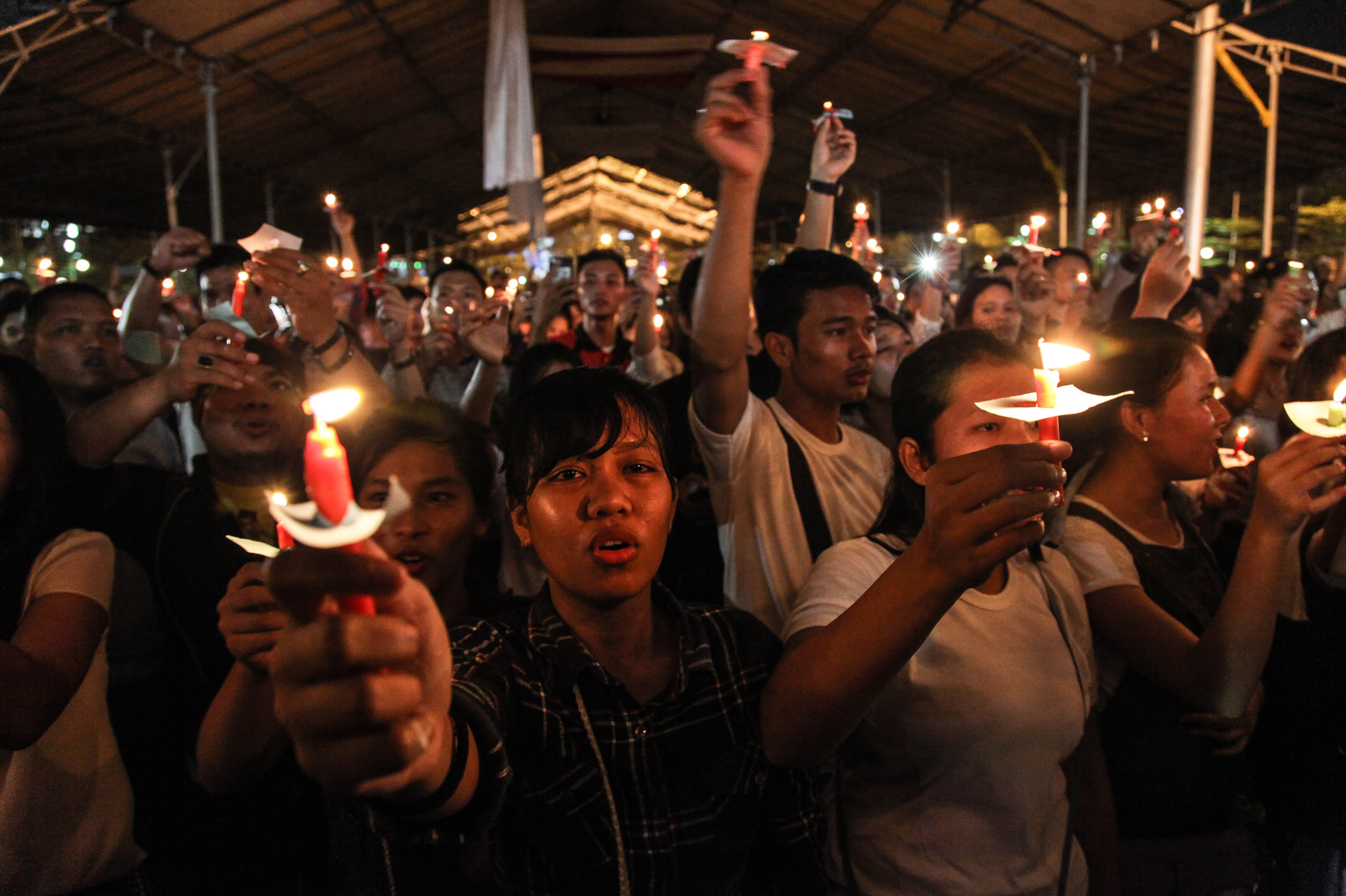 This picture taken on May 13, 2018 shows a candlelight vigil in the city of Medan on Indonesia's Sumatra island to support the victims and their relatives of a series attacks at churches in Surabaya, East Java.
