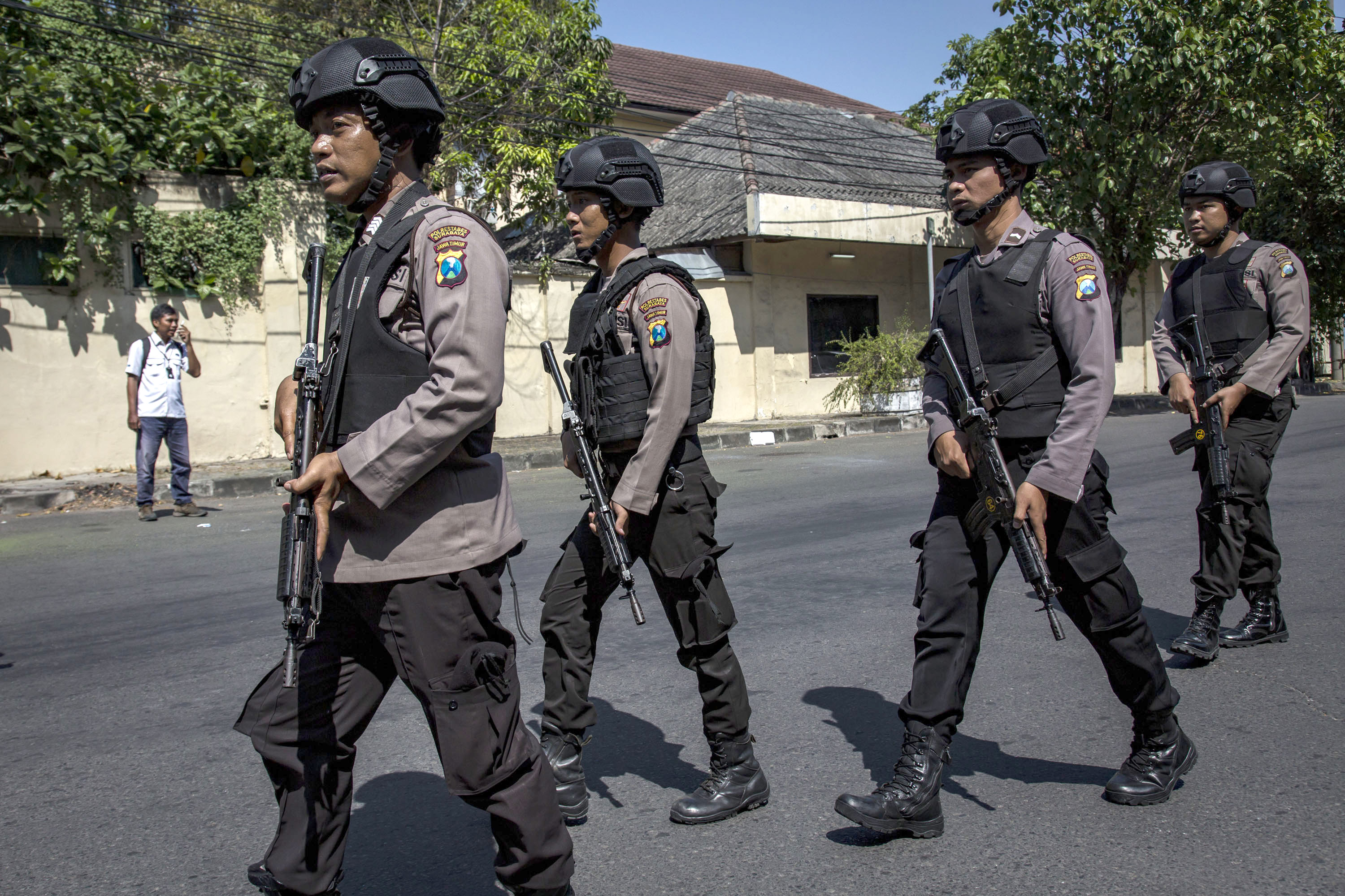 Indonesian police stand guard outside the Surabaya police station following another explosion on May 14, 2018 in Surabaya, Indonesia.