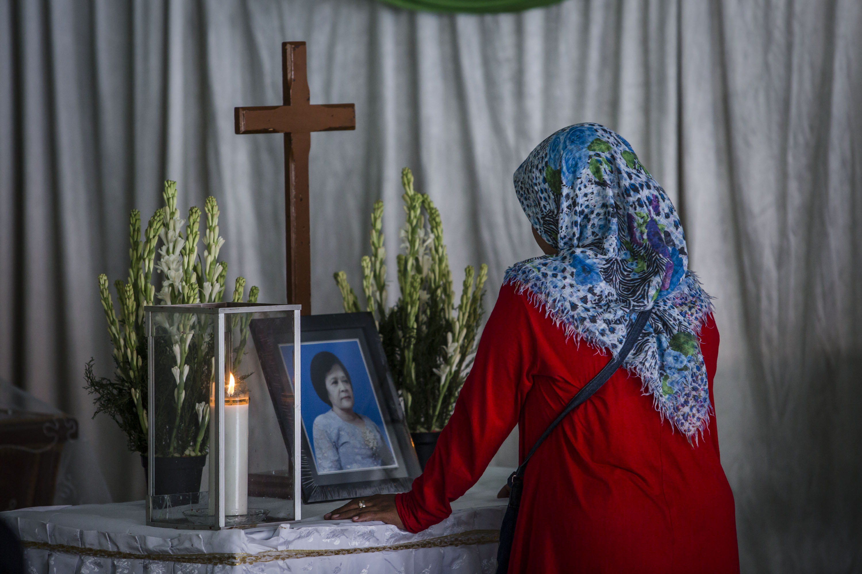 Yuliastuti, grieves in front coffin of Sri Puji, one of the victims killed at Surabaya Centre Pentecostal Church attack, following a blast at the church a day earlier on May 14, 2018 in Surabaya, Indonesia.