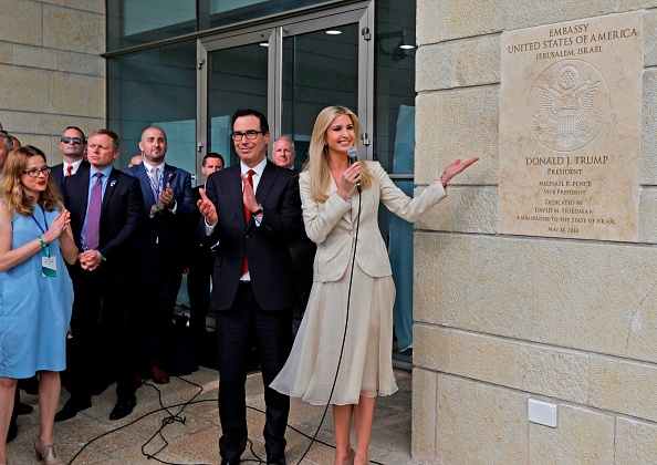 Treasury Secretary Steve Mnuchin claps as US President's daughter Ivanka Trump unveils an inauguration plaque during the opening of the U.S. embassy in Jerusalem on May 14, 2018. (Getty)