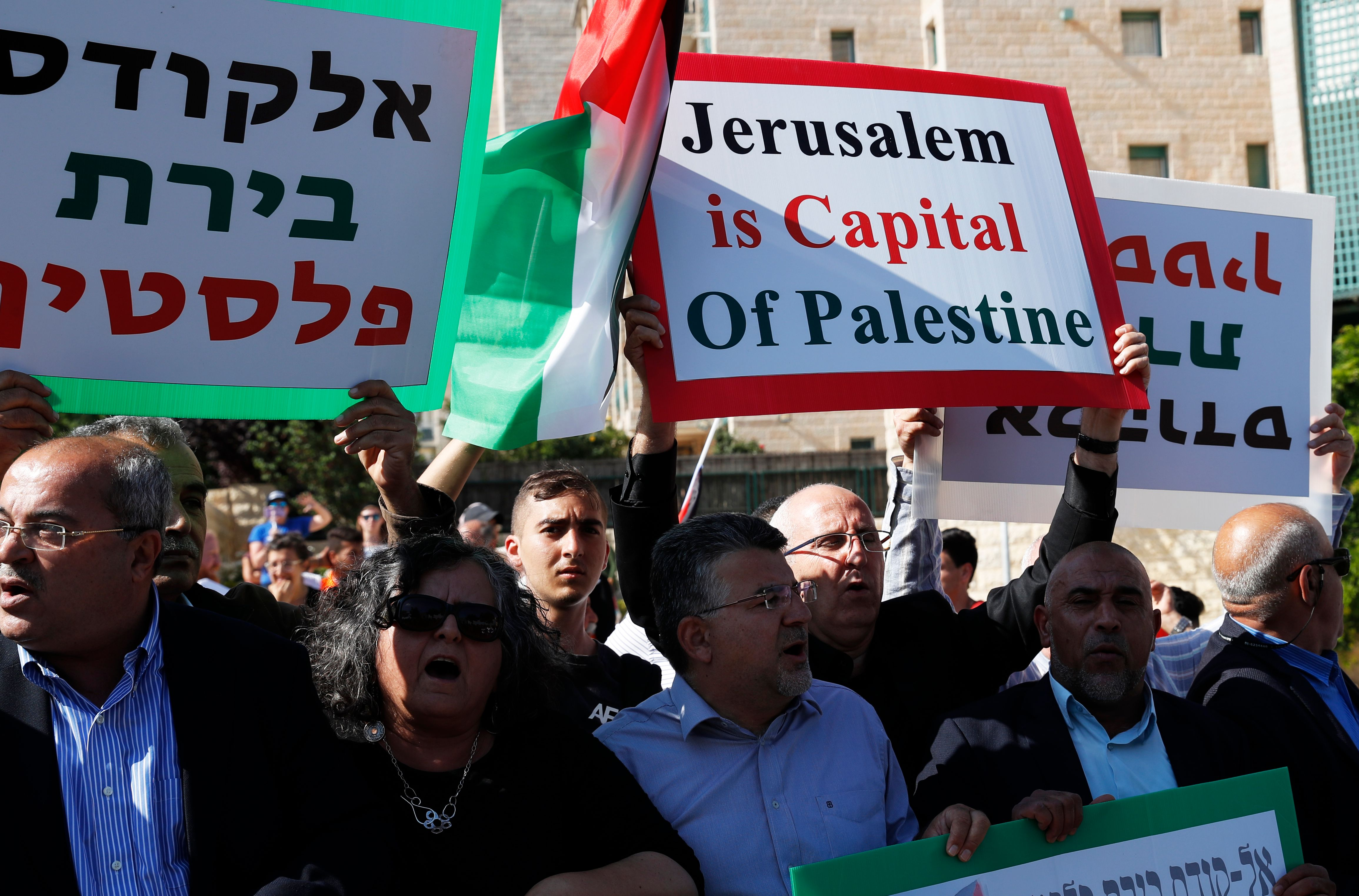 Palestinians demonstrate outside the new US embassy as the ceremony to inaugurate the United States' controversial embassy in Jerusalem began on May 14, 2018.
