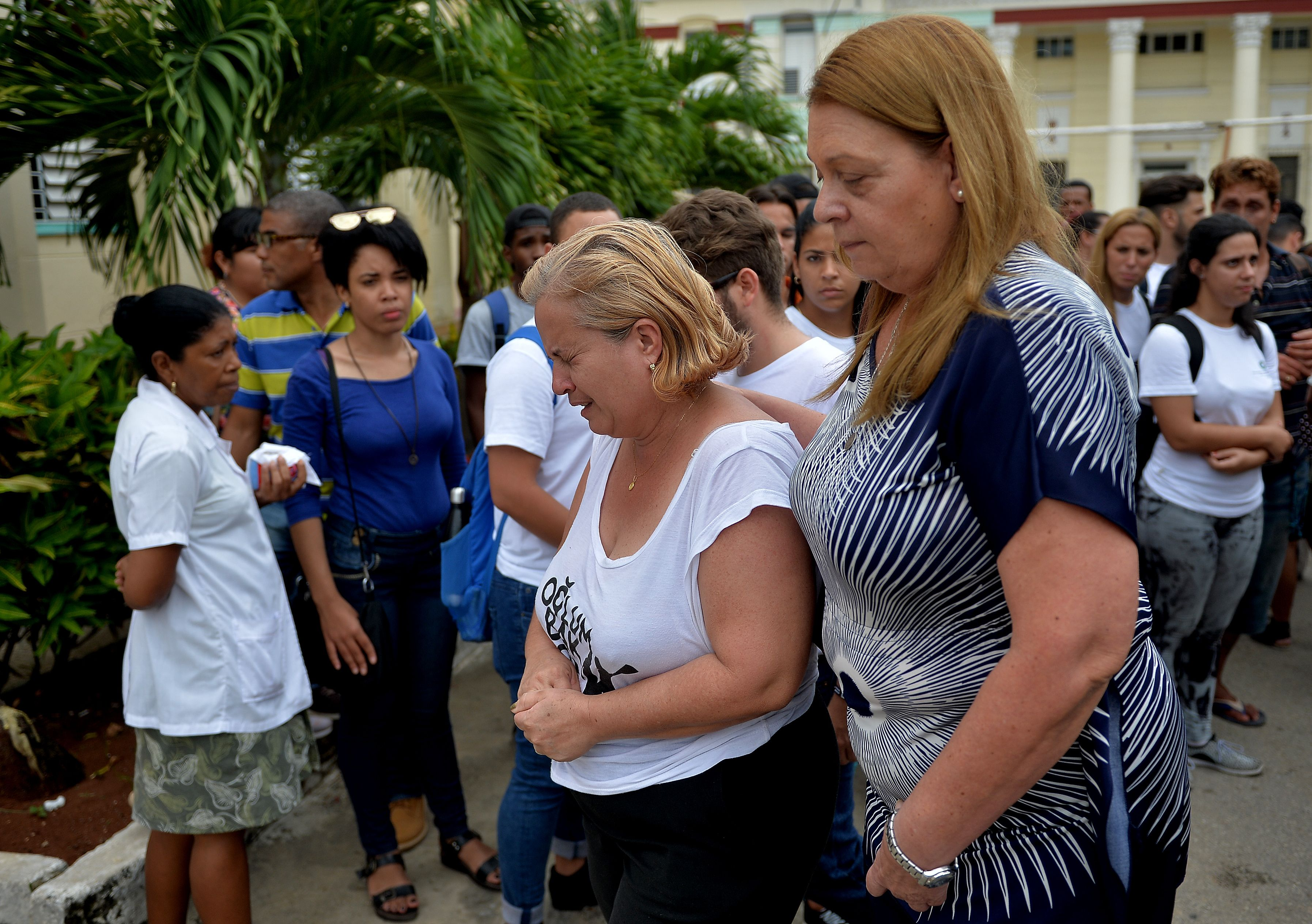 Amparo Font, mother of 23-year-old Gretell Landrove Font cries after receiving a medical report at the Calixto Garcia Hospital in Havana, on May 21, 2018.