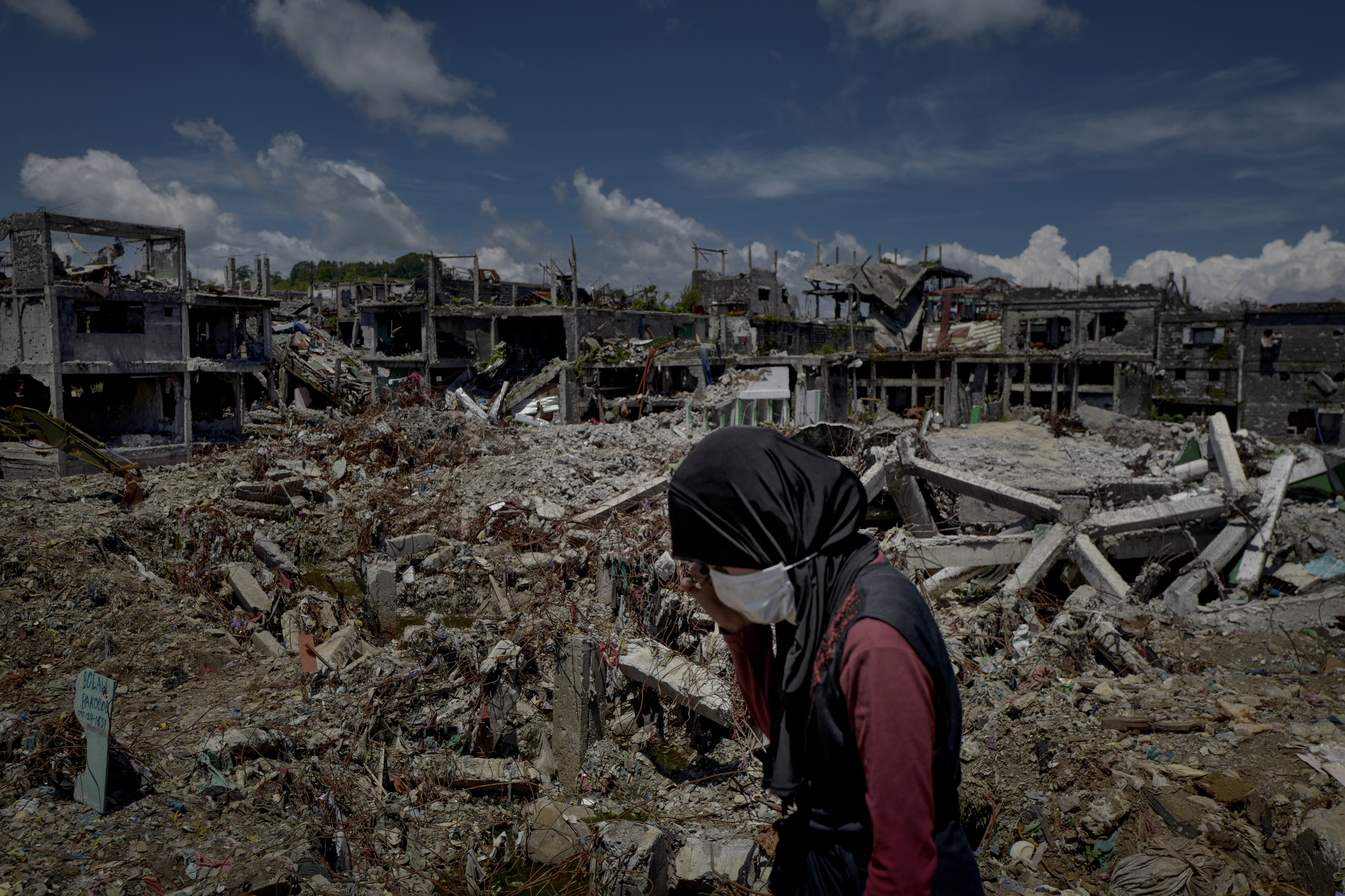 A woman stands amid the destruction inside Marawi city on May 10, 2018 in Marawi, Philippines.