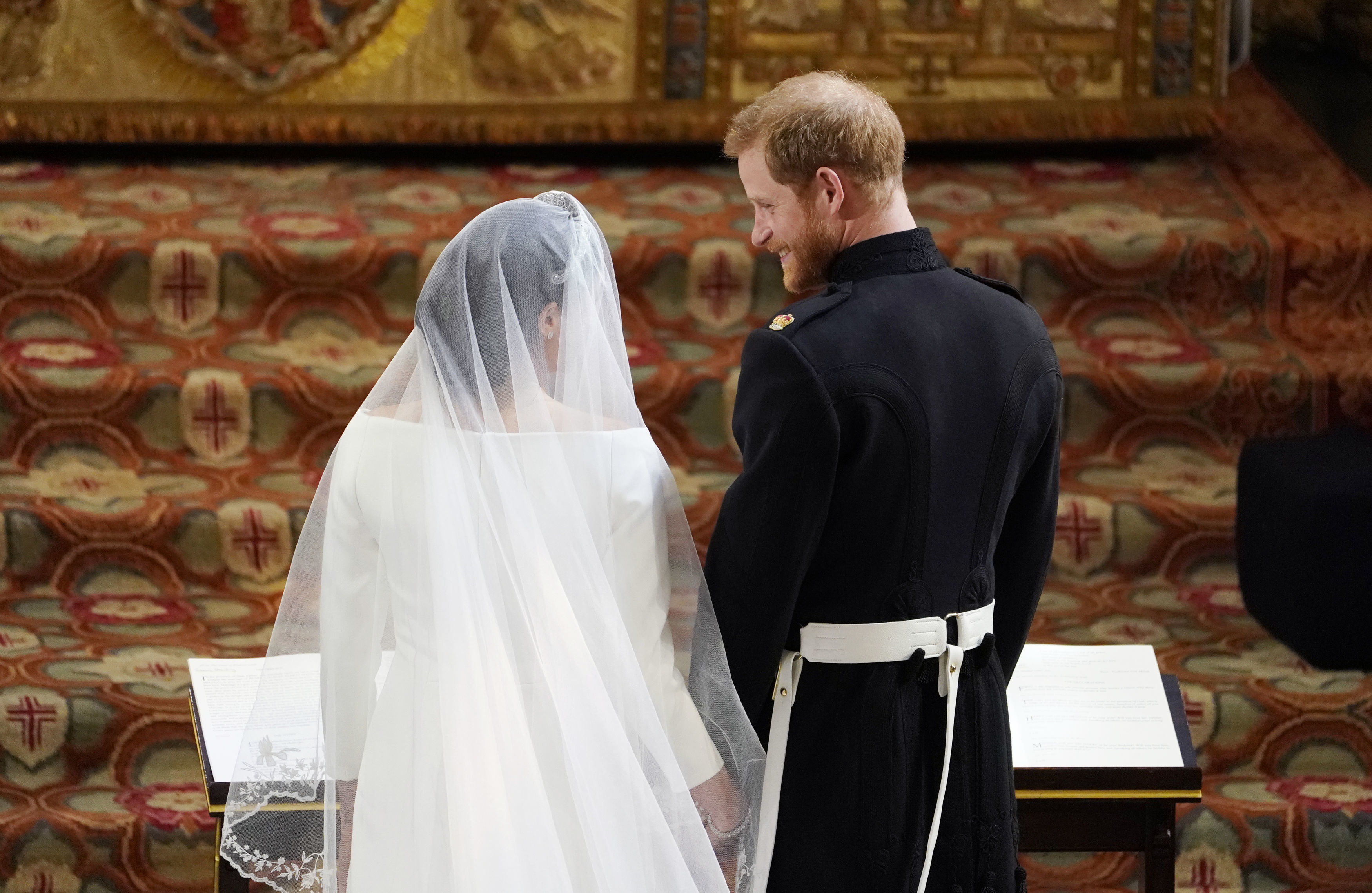 Prince Harry stands at the altar with Markle during the ceremony.