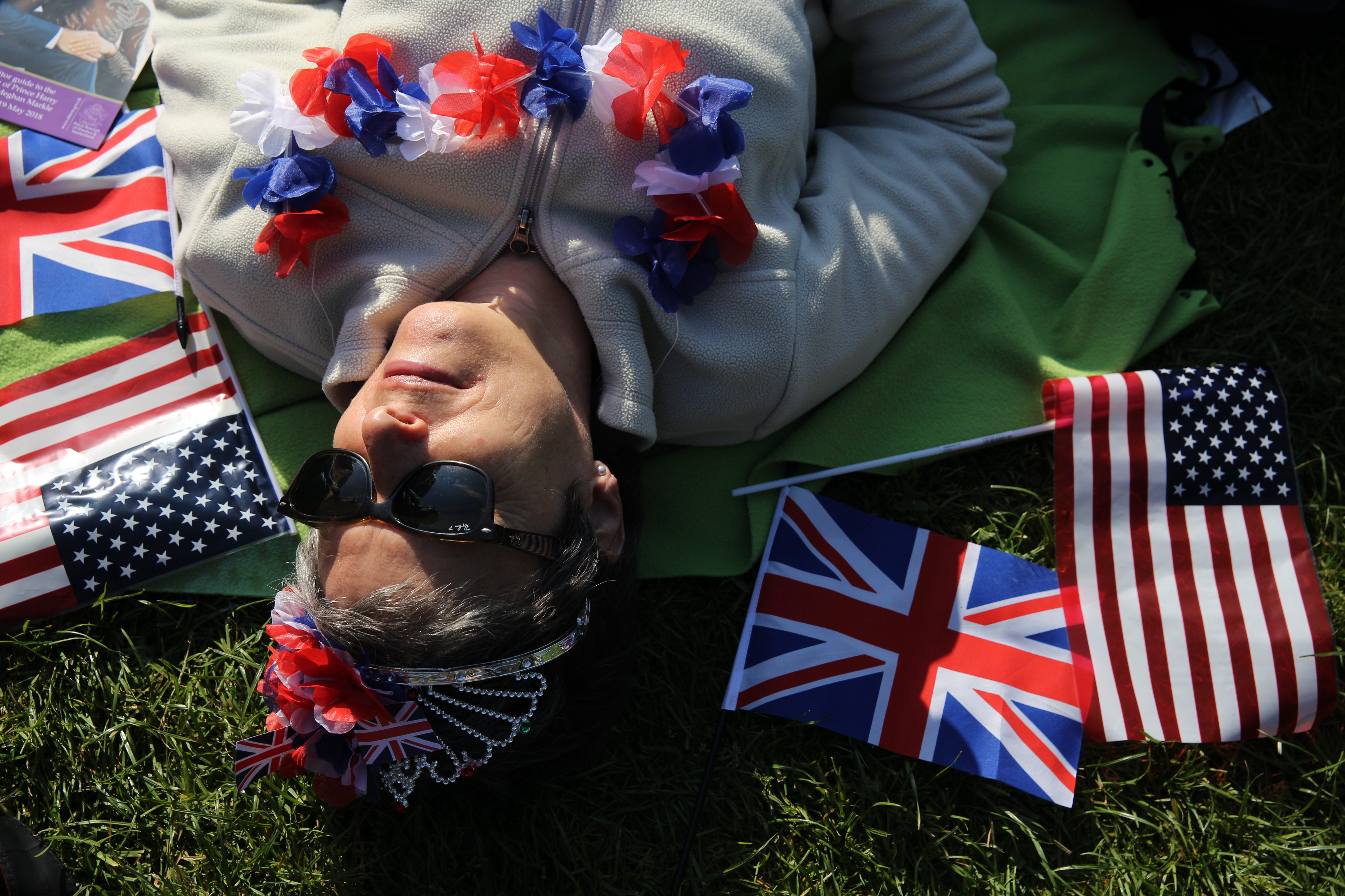 A woman rests along the Long Walk while waiting for the royal family and guests to arrive at Windsor Castle.
