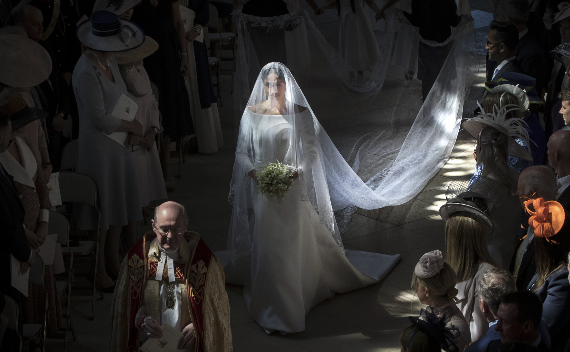 Markle walks down the aisle in St. George's Chapel.