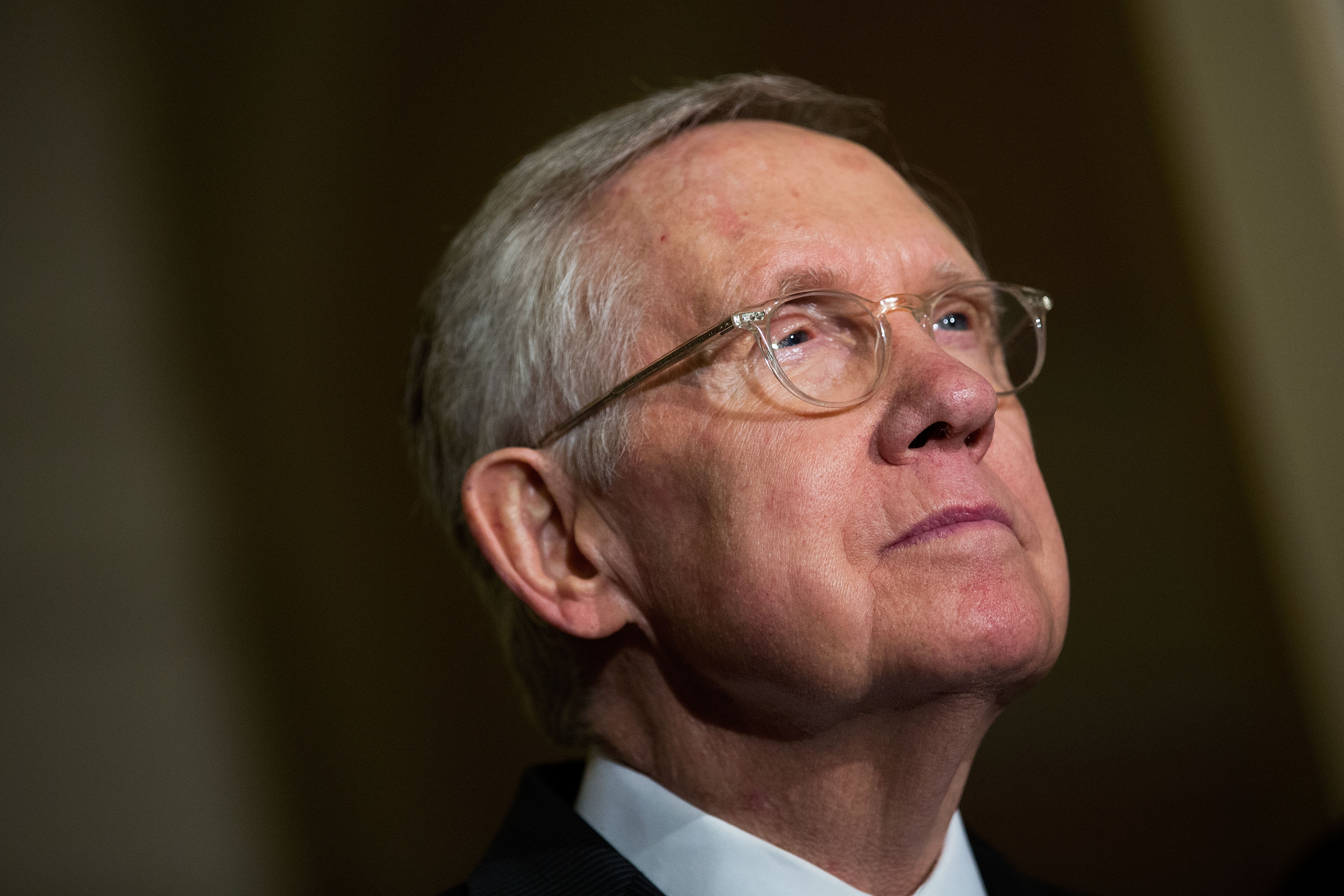 Senate Minority Leader Harry Reid (D-NV) listens to questions from reporters during a news conference after their weekly policy meeting with Senate Republicans, at the U.S. Capitol, May 10, 2016, in Washington, DC.