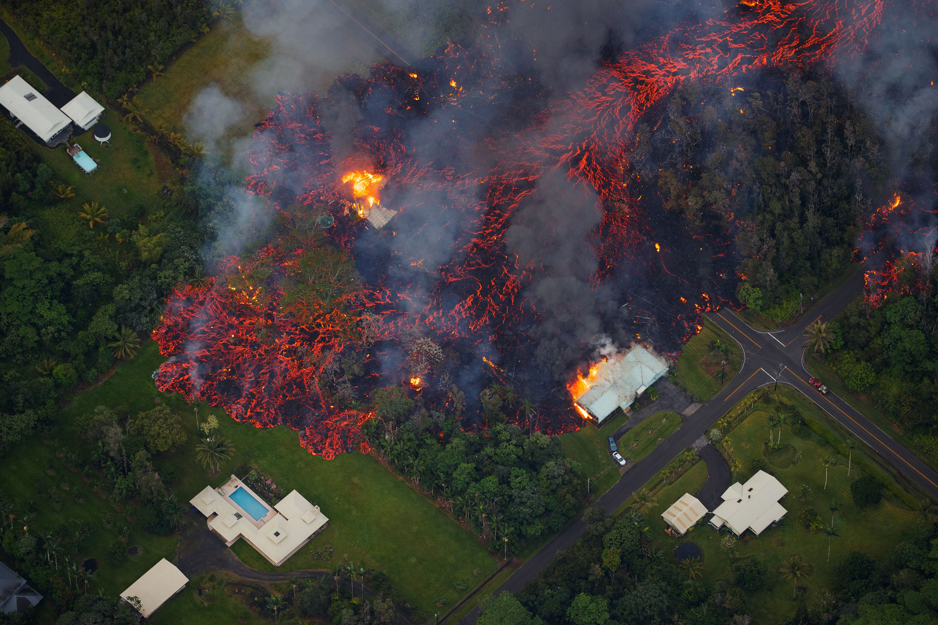 A fissure eruption releases lava and gas in the Leilani Estates subdivision near Hawaii's Kilauea volcano on May 6, 2018.