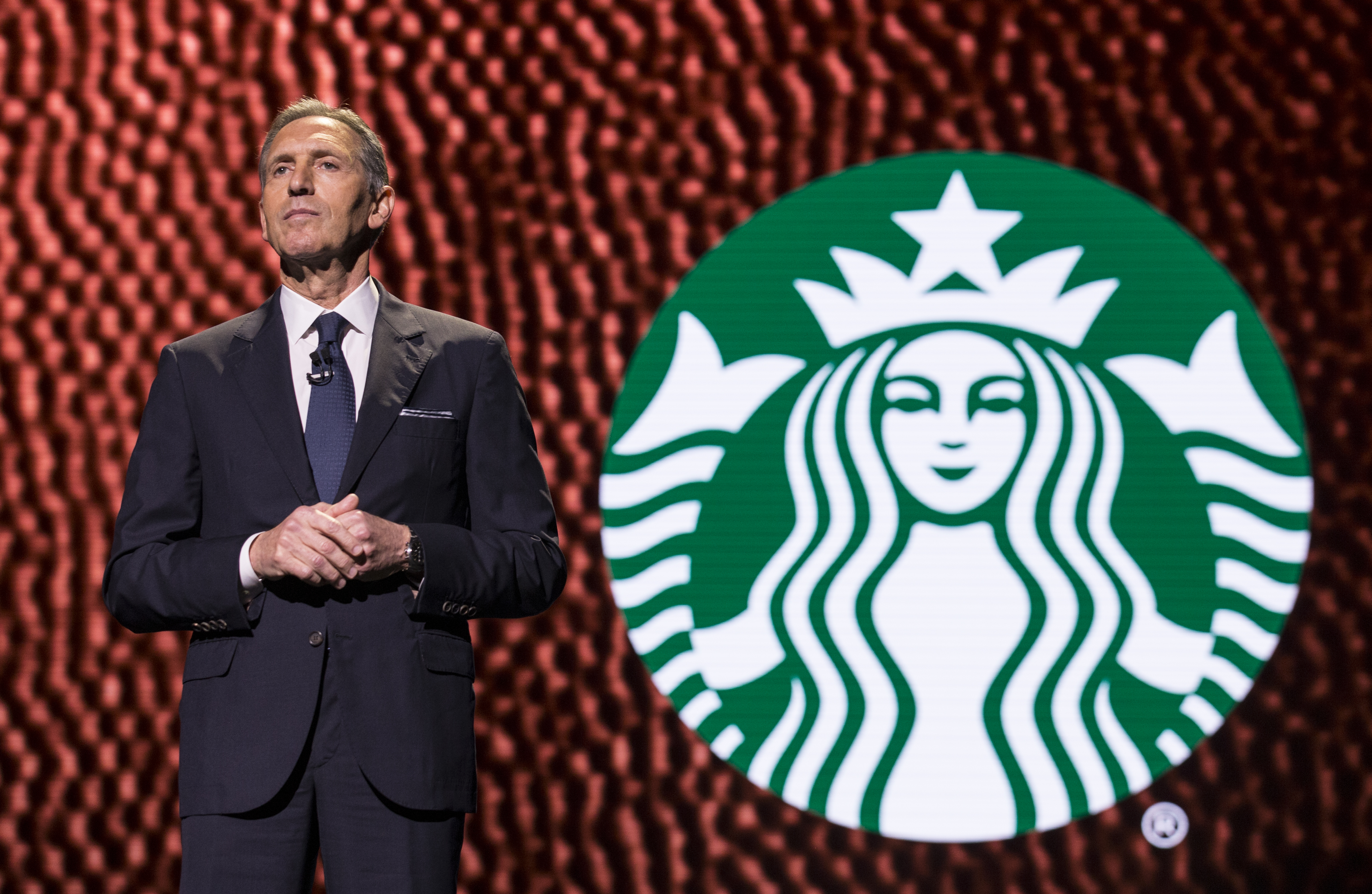 CEO Howard Schultz pauses while speaking during the Starbucks annual meeting of shareholders on March 22, 2017 in Seattle, Washington. The 25th annual meeting will be the last for Schultz as CEO. (Photo by Stephen Brashear/Getty Images)
