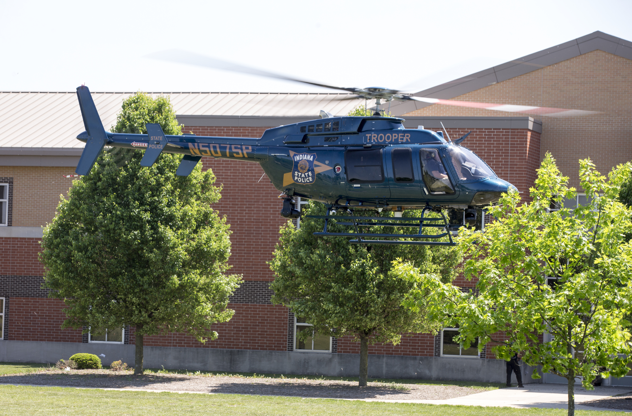 An Indiana State Police helicopter lifts off after a shooting at Noblesville West Middle School in Noblesville, Ind., on Friday, May 25, 2018. A male student opened fire at the suburban Indianapolis school wounding another student and a teacher before being taken into custody, authorities said.