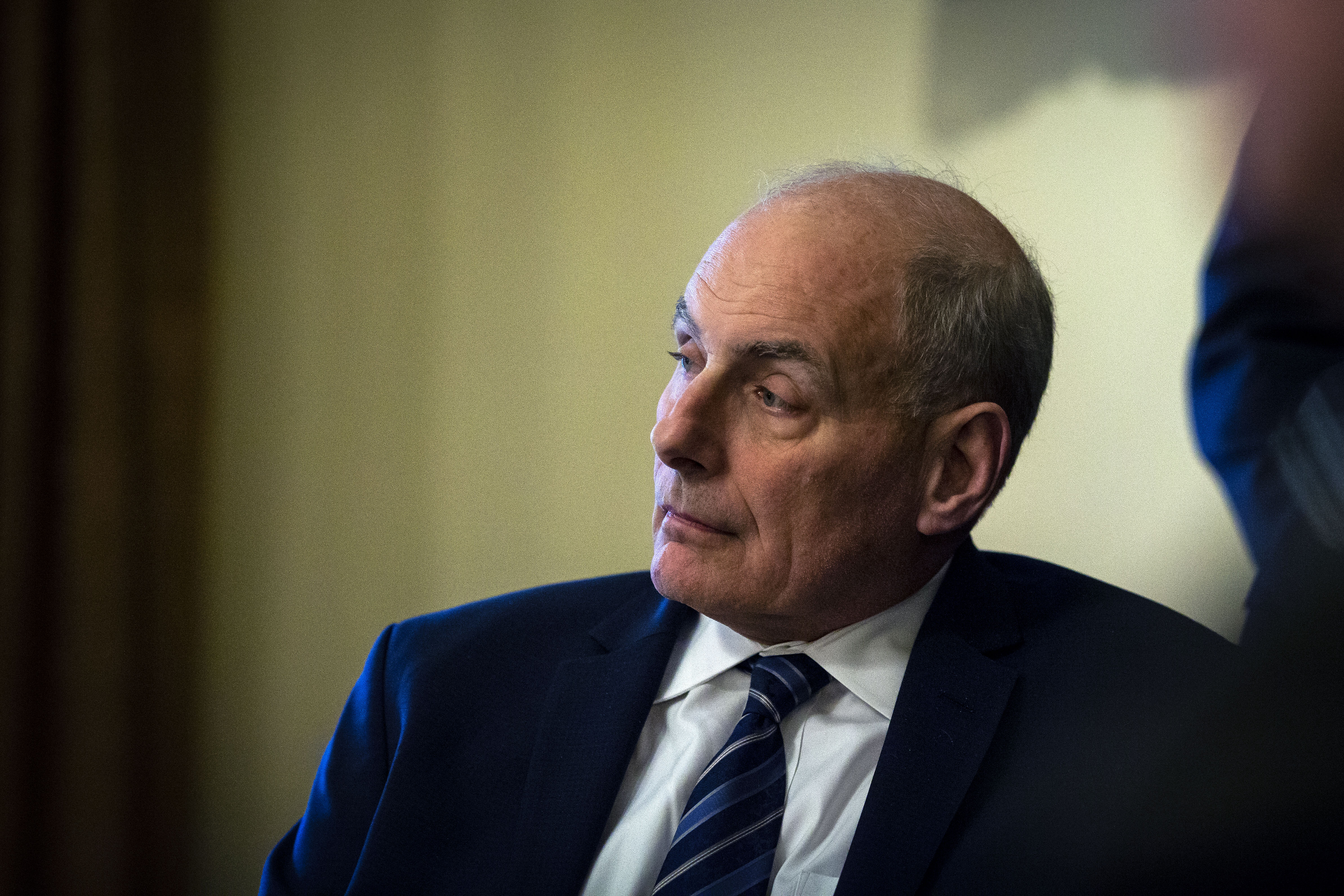 John Kelly, White House chief of staff, listens as U.S. President Donald Trump, not pictured, speaks during a meeting with senior military leadership in the Cabinet Room of the White House in Washington, D.C., U.S., on Monday, April 9, 2018.