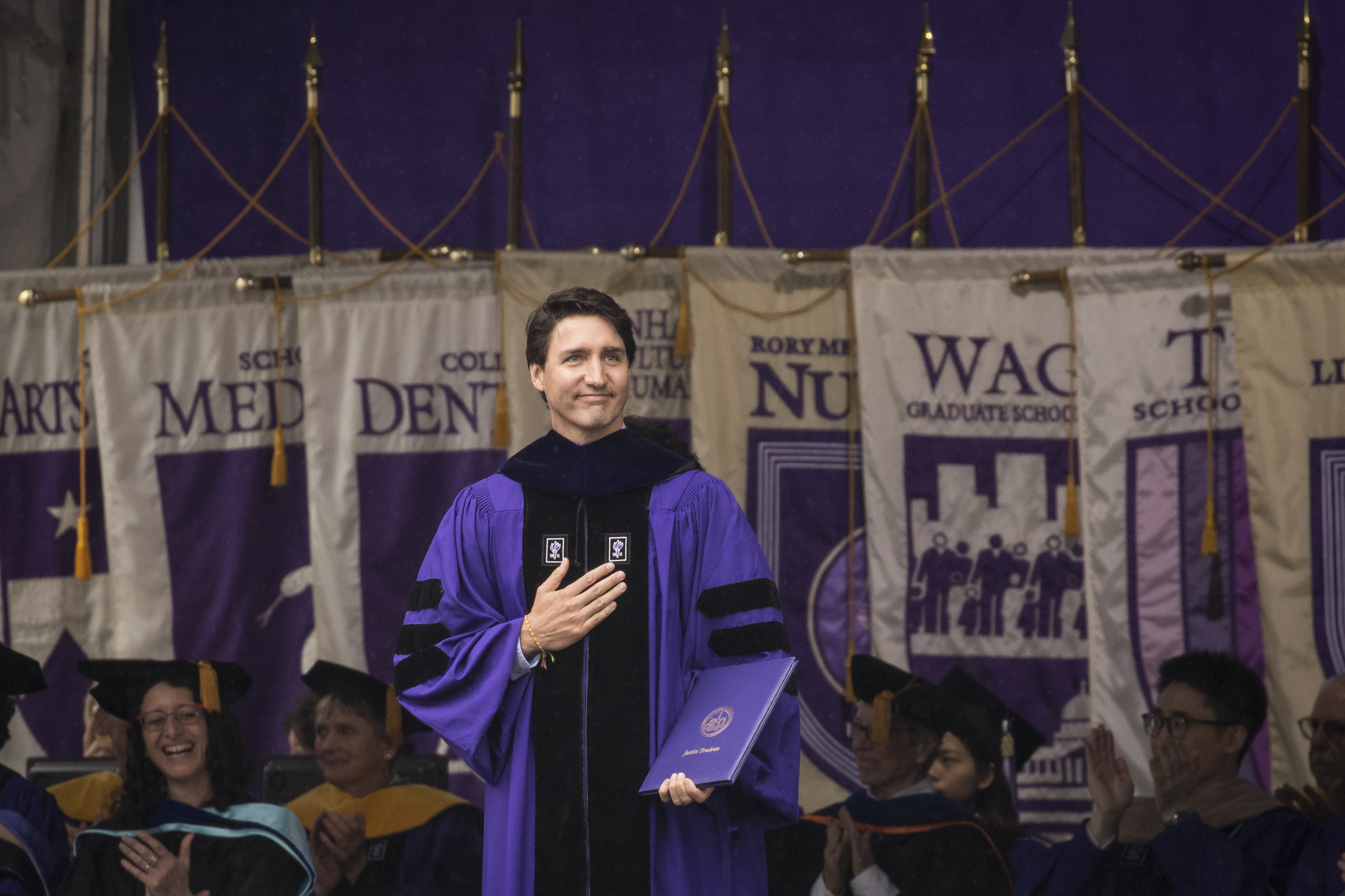 Canadian Prime Minister Justin Trudeau acknowledges the crowd after receiving an honorary doctor of laws degree at New York University's commencement ceremony at Yankee Stadium on May 16, 2018 in the Bronx borough of New York City.