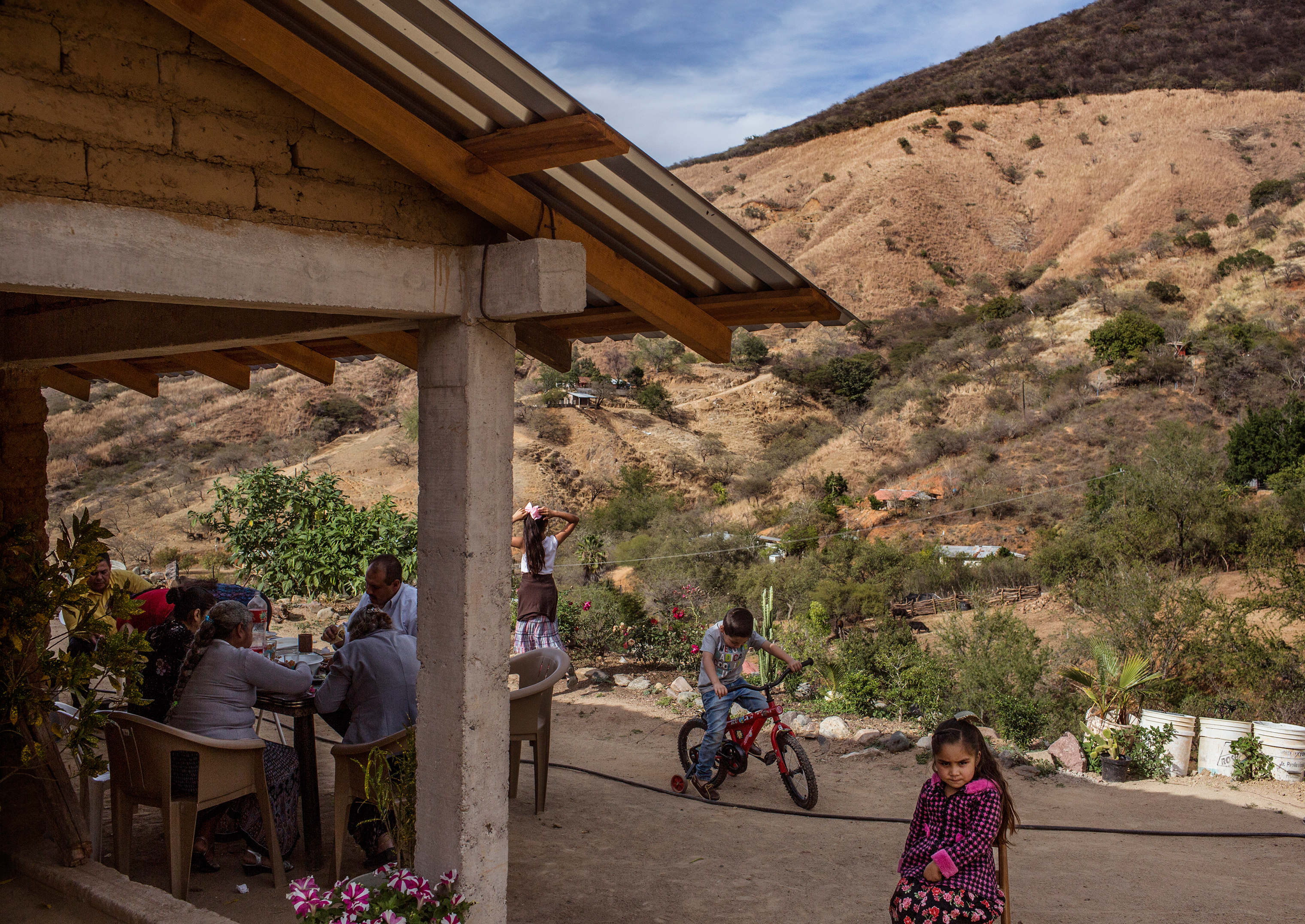 José, who calls Guzmán an uncle, hosts a barbecue with family and friends near Guzmán's mother's compound.