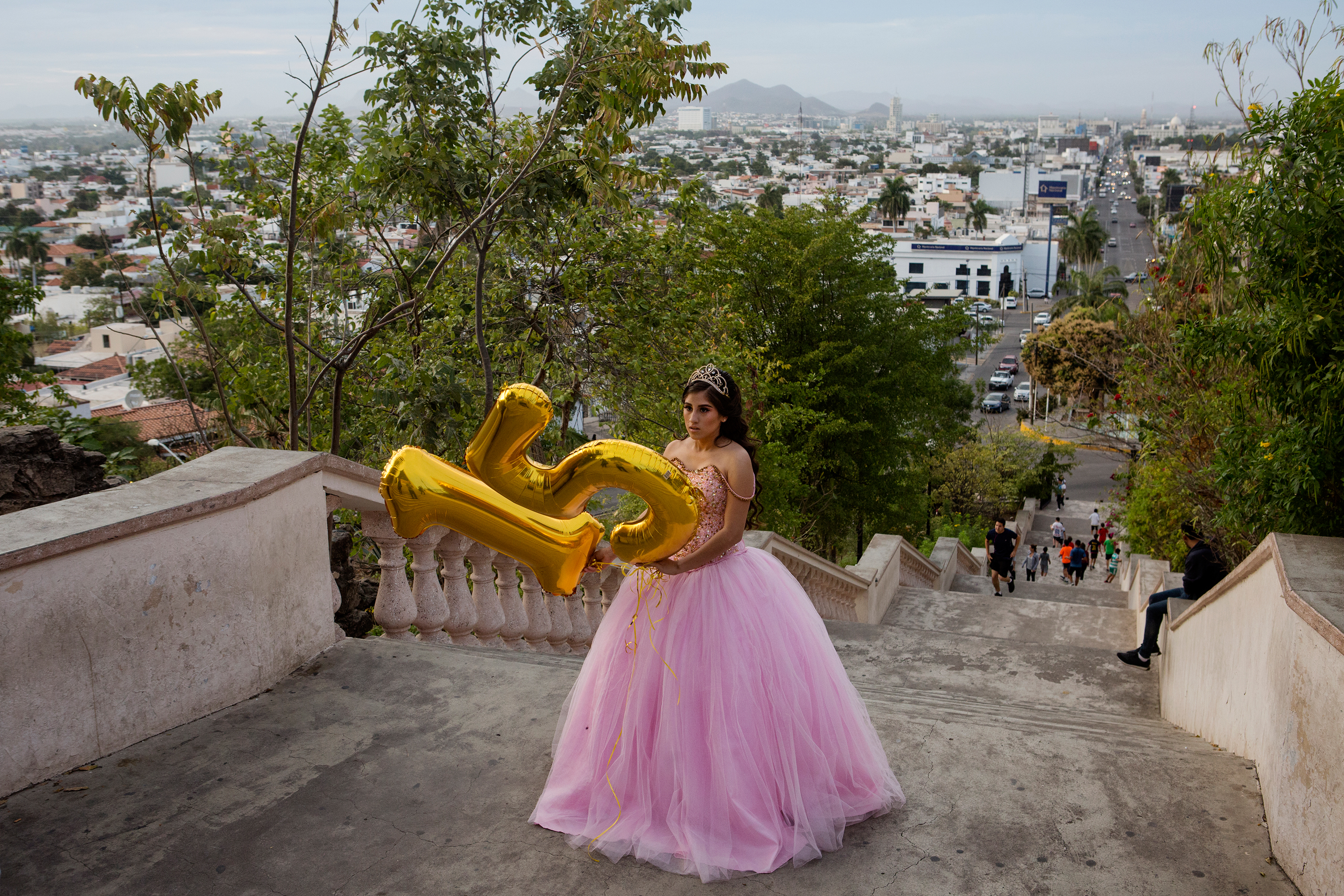 Lacey Carillo Quintera, 15, celebrates her quinceañera by taking photos with her family at the La Lomita overlook in Culiacán, Sinaloa, in February.