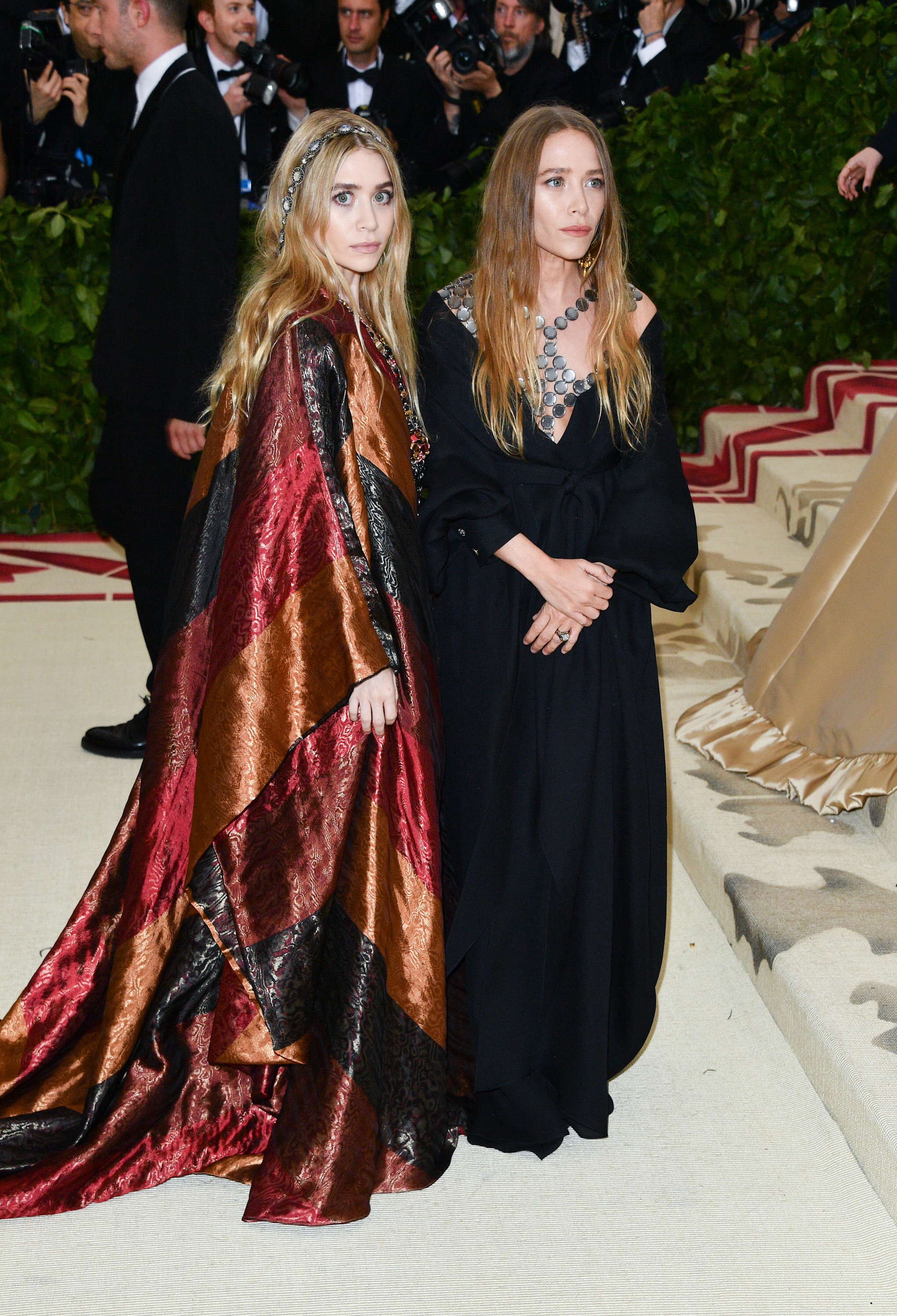 Ashley Olsen (L) and Mary-Kate Olsen attend the Heavenly Bodies: Fashion & The Catholic Imagination Costume Institute Gala at the Metropolitan Museum of Art on May 7, 2018 in New York City. (Photo by George Pimentel/Getty Images)