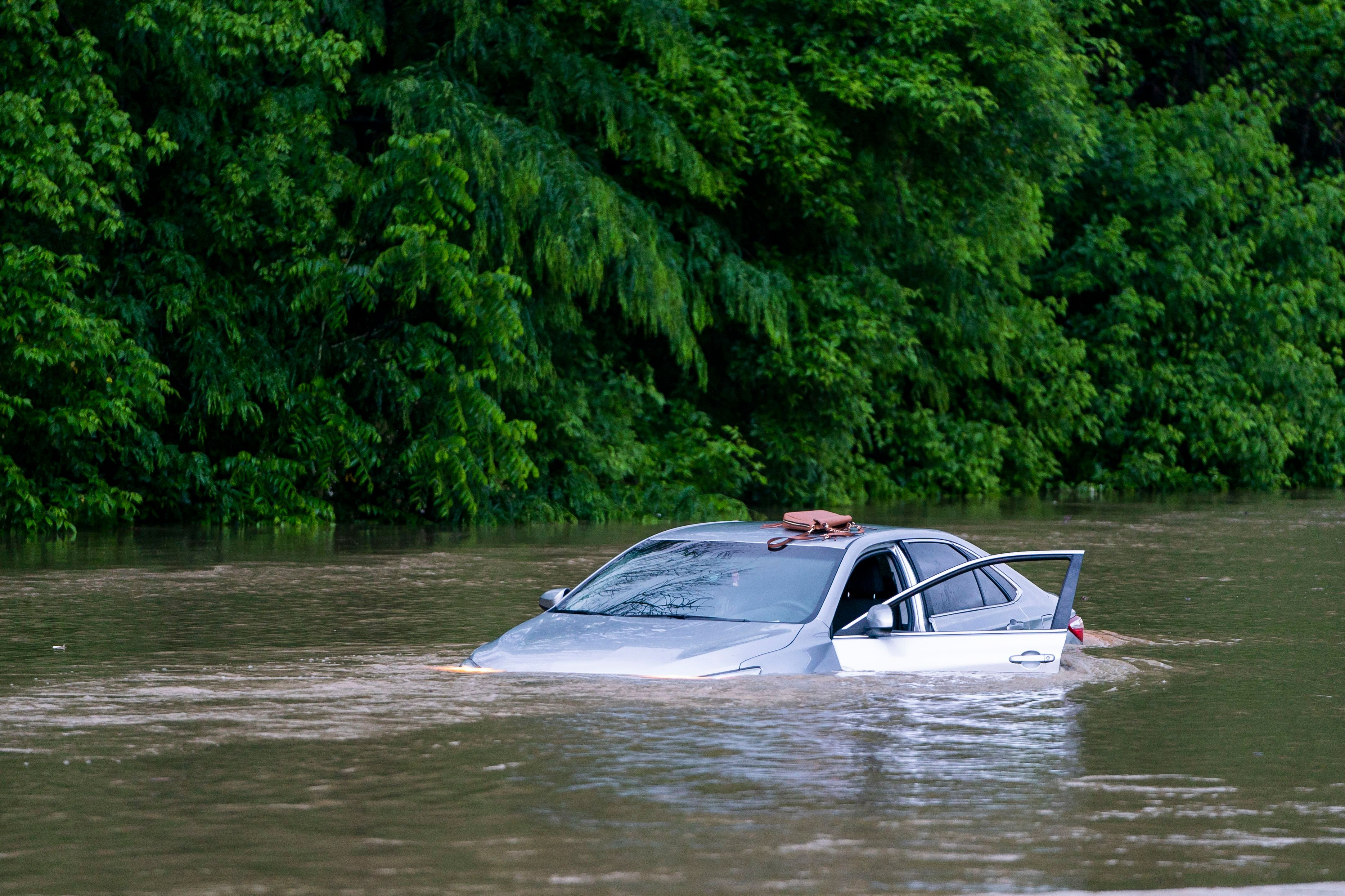 A flooded car on Columbia Pike after a flash flood in Oakland Mills, Maryland, USA, 27 May 2018. The National Weather Service stated as much as 9.5 inches of rain fell in the area. Flash floods ravage Maryland, Oakland Mills, USA - 27 May 2018