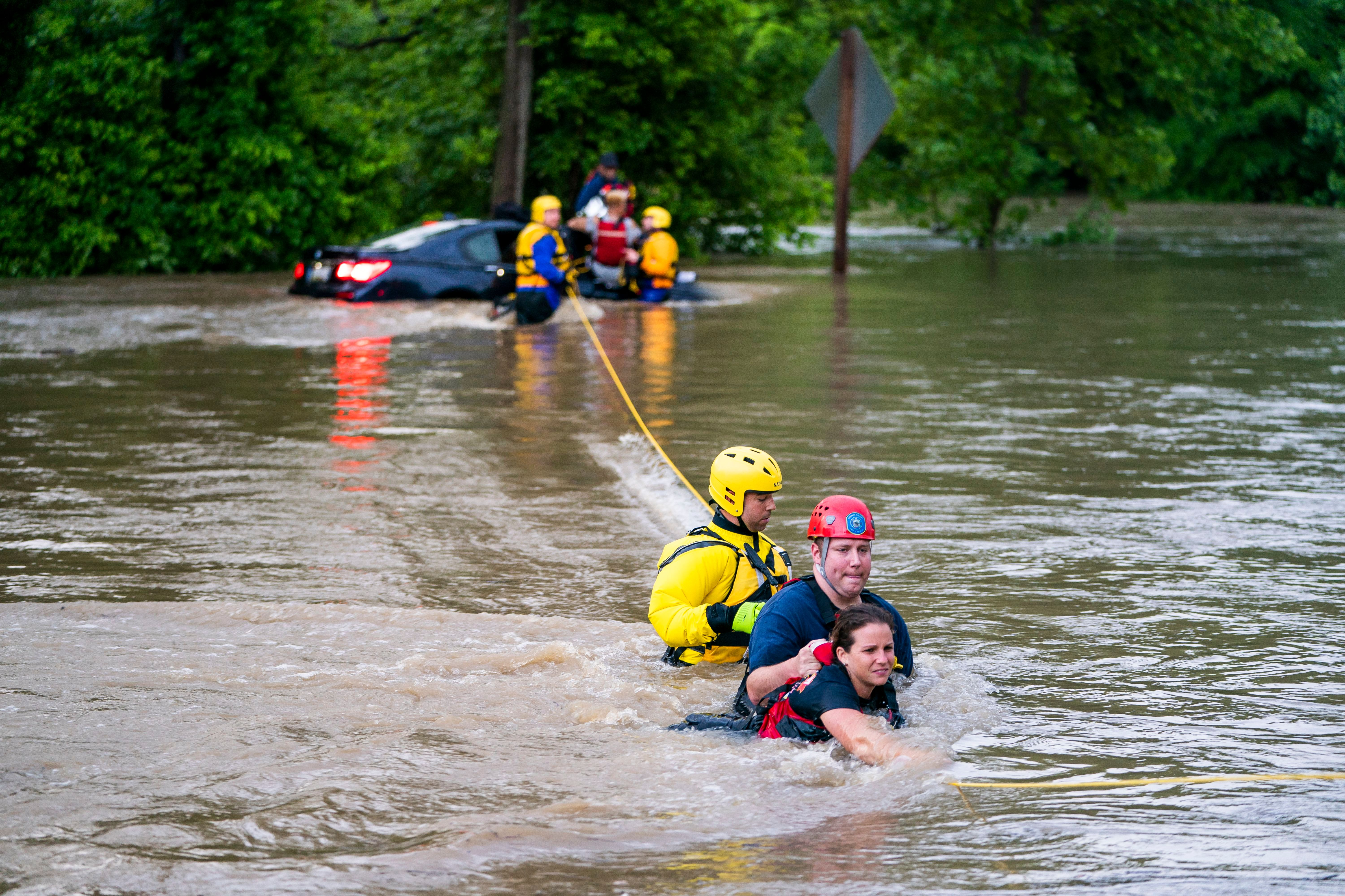 Commuters are rescued from a flooded car on Columbia Pike after a flash flood in Oakland Mills, Maryland, USA, 27 May 2018. The National Weather Service stated as much as 9.5 inches of rain fell in the area. Flash floods ravage Maryland, Oakland Mills, USA - 27 May 2018