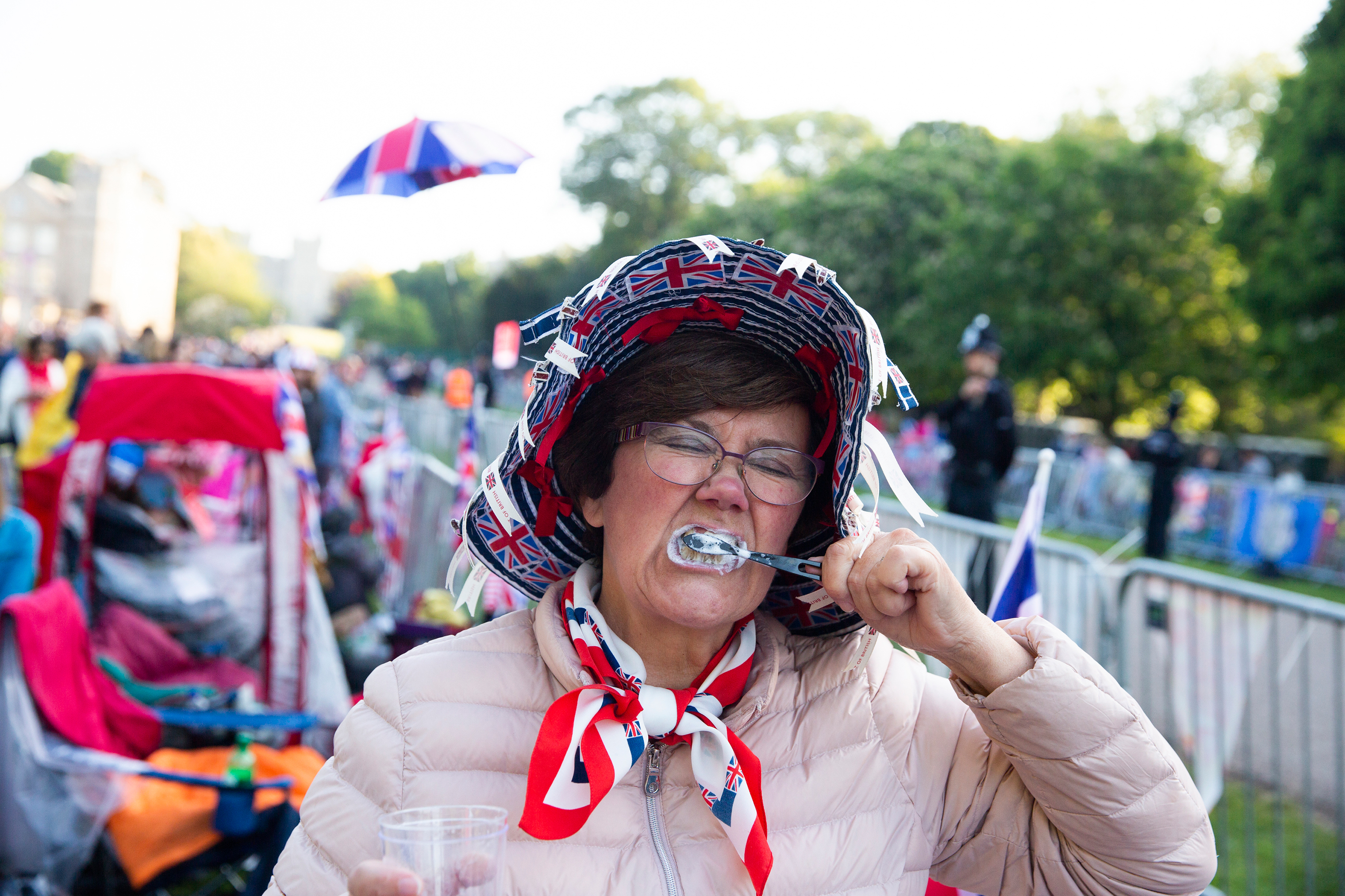 A woman brushes her teeth on the morning of the royal wedding.