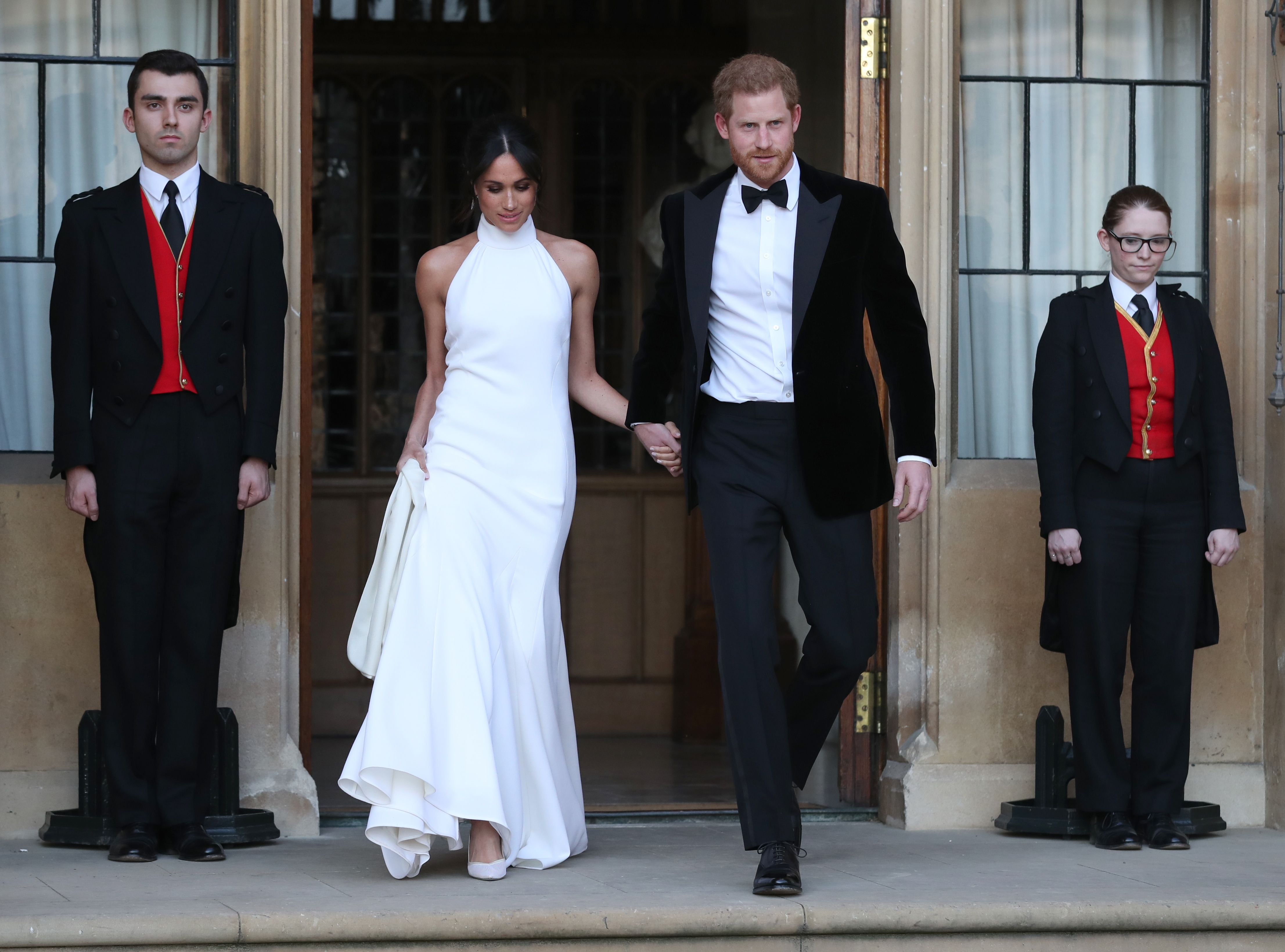 Newly married Meghan Markle, Duchess of Sussex, wears a Stella McCartney wedding reception dress while leaving Windsor Castle in Windsor on May 19, 2018 after their wedding to attend an evening reception at Frogmore House.