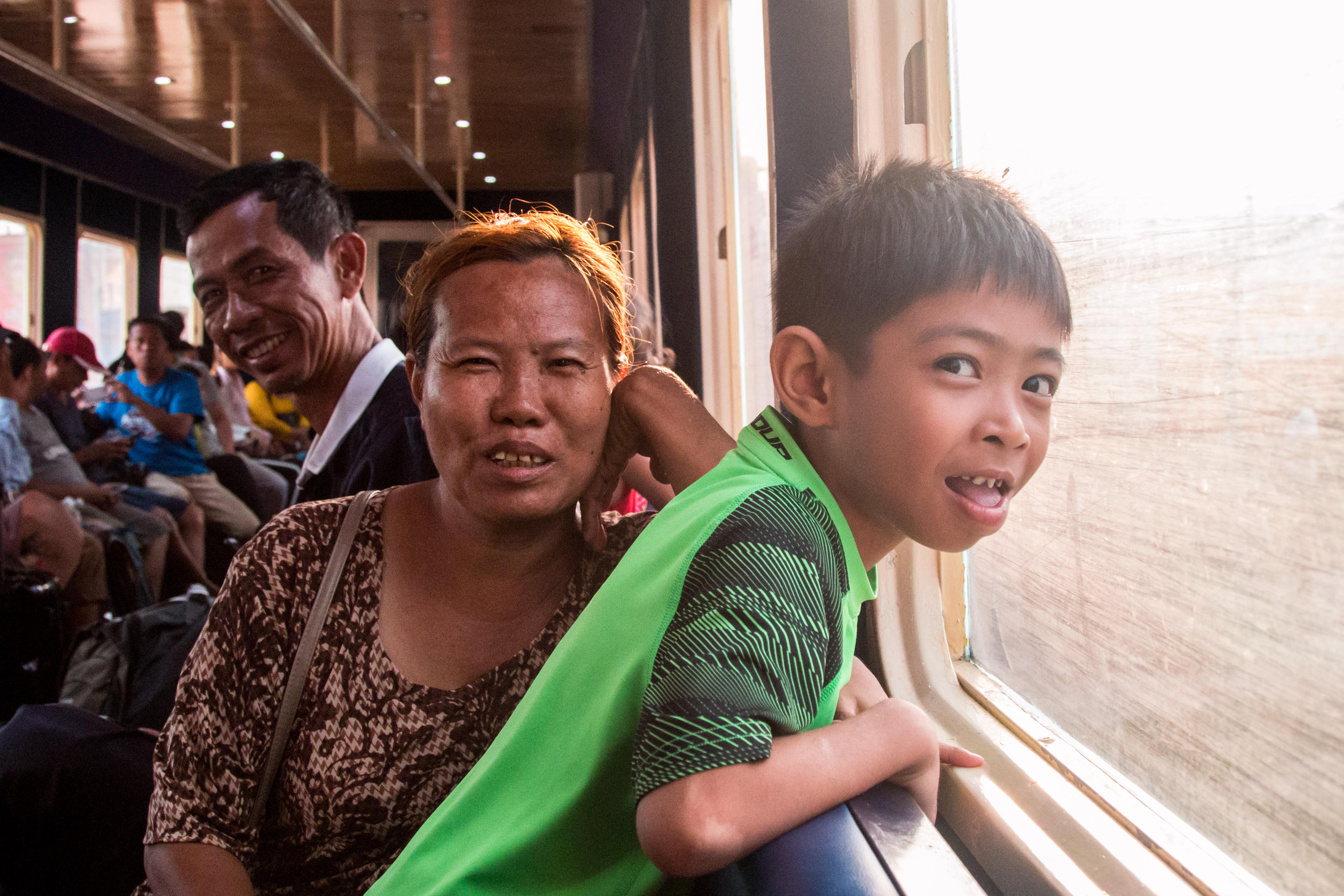 The thrill of the ride. Passengers seeking respite from the heat ride Phnom Penh's new airport shuttle train.