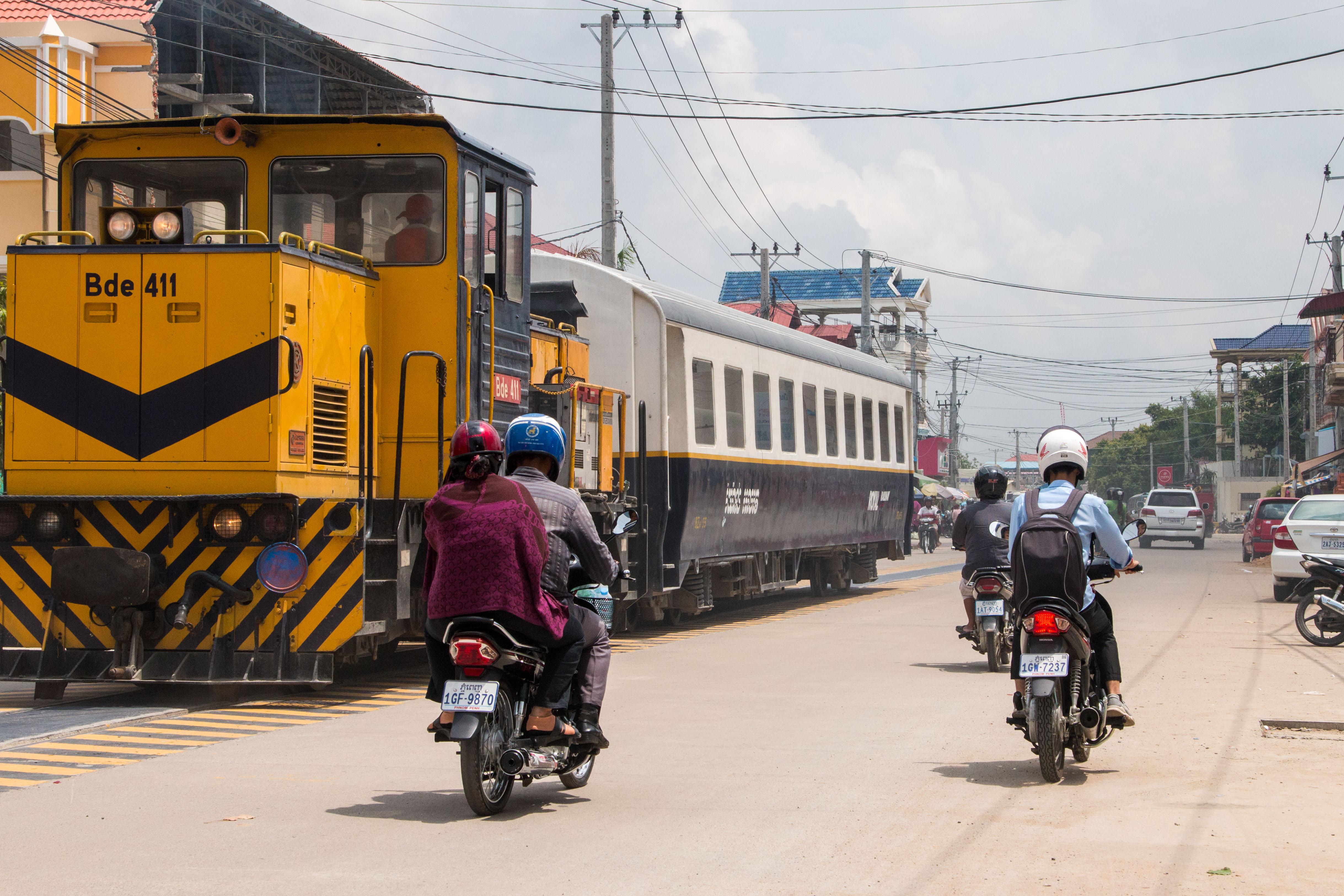 Road space is at a premium as the train shuttles to the airport in Phnom Penh.