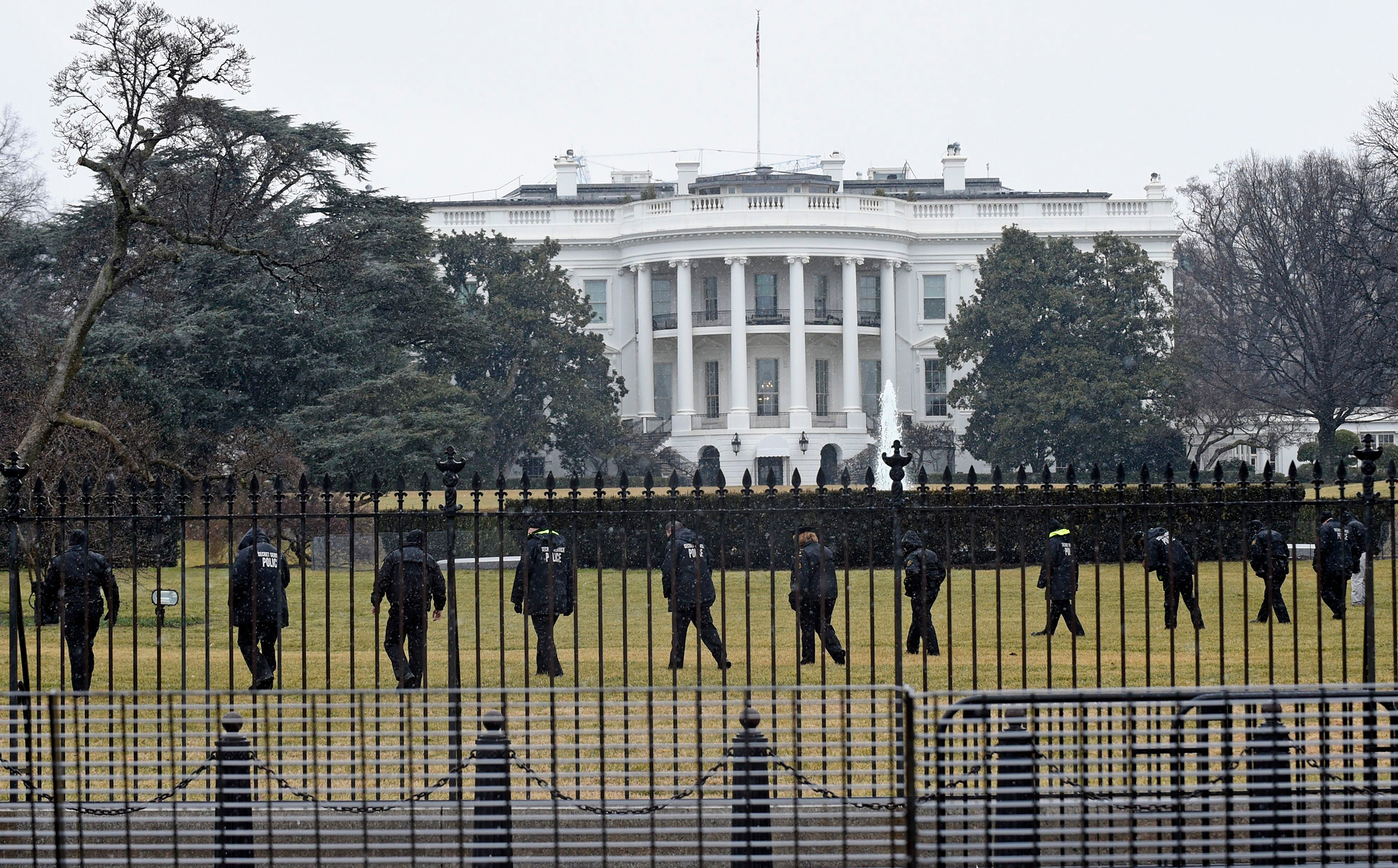 Secret Service officers search the south grounds of the White House in Washington, after a device, possibly an unmanned aerial drone, was found on the White House grounds on Jan. 26, 2015.